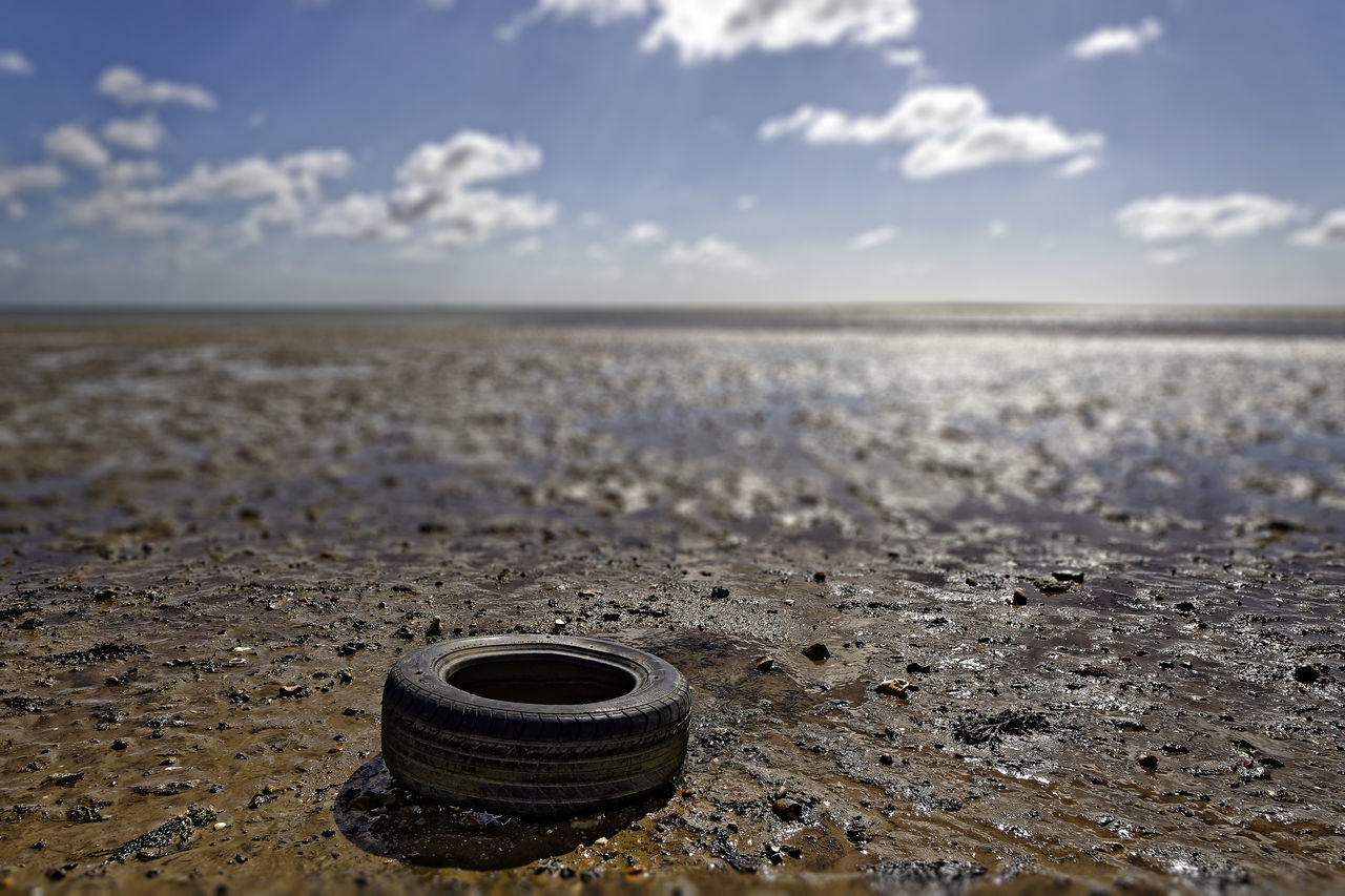 Old Tyre Discarded on Beach Beach Blue Sky Car Coast Coastal Coastline Damage Discarded Dispose Dumped Ecology Fly Tipping Garbage Junk Ocean Old Pollution Refuse Rubber Sea Seaside Shore Toxic Tyre Water