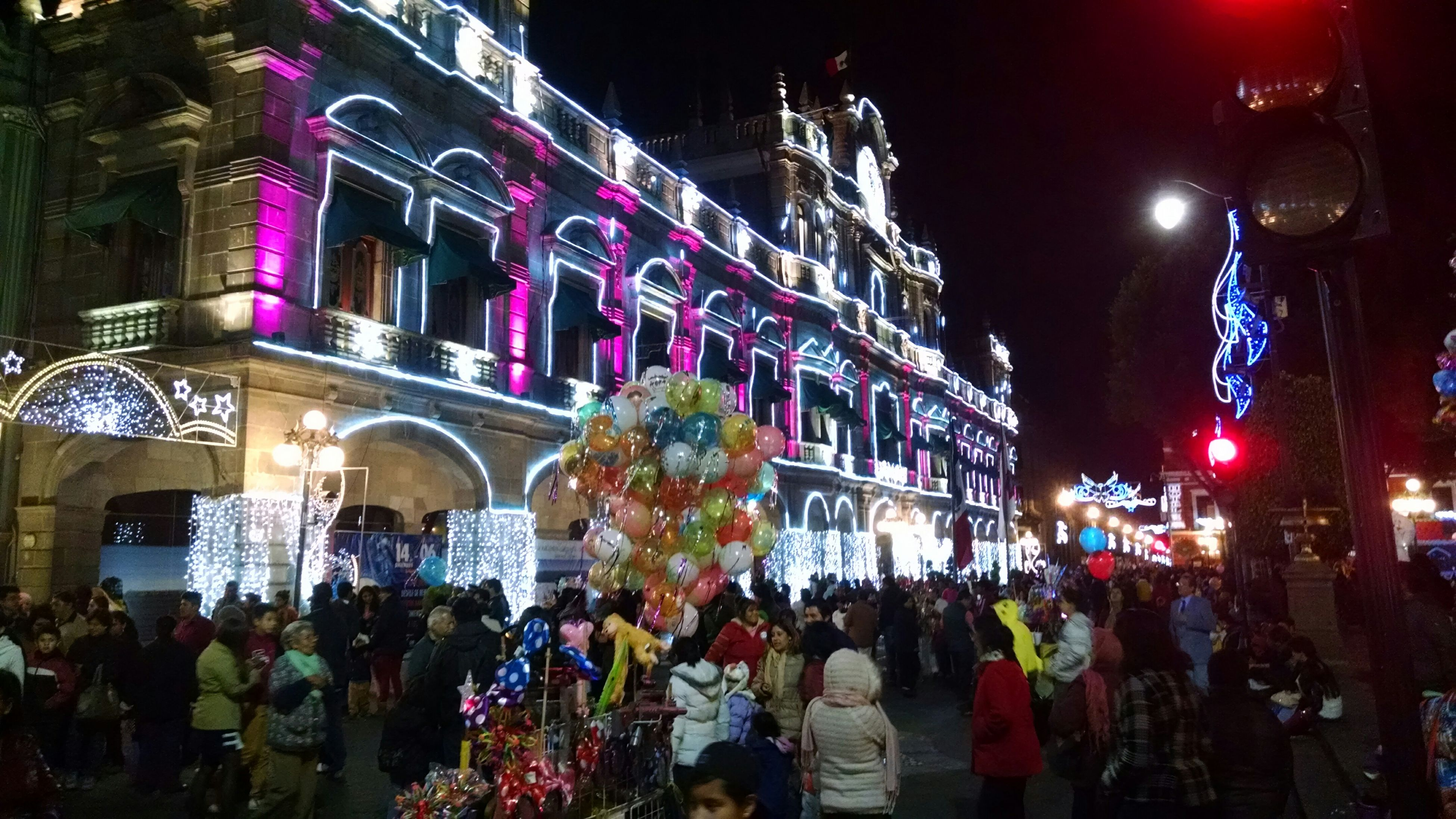 large group of people, illuminated, night, crowd, person, architecture, built structure, building exterior, men, celebration, lifestyles, city, street, city life, lighting equipment, leisure activity, mixed age range, decoration, traditional festival