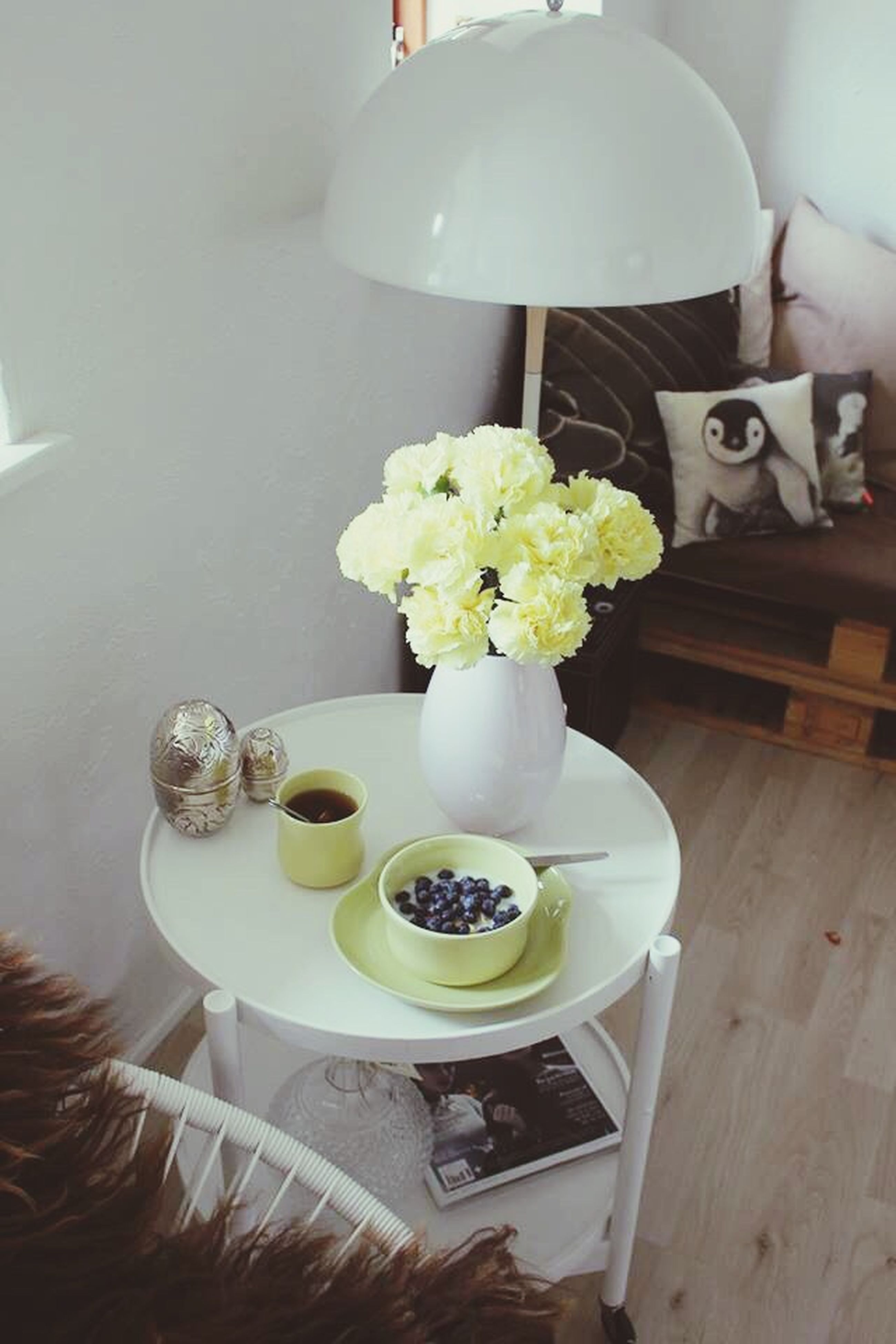 indoors, table, flower, freshness, vase, food and drink, home interior, still life, high angle view, chair, plate, white color, food, spoon, bowl, wood - material, coffee cup, dining table, potted plant, decoration