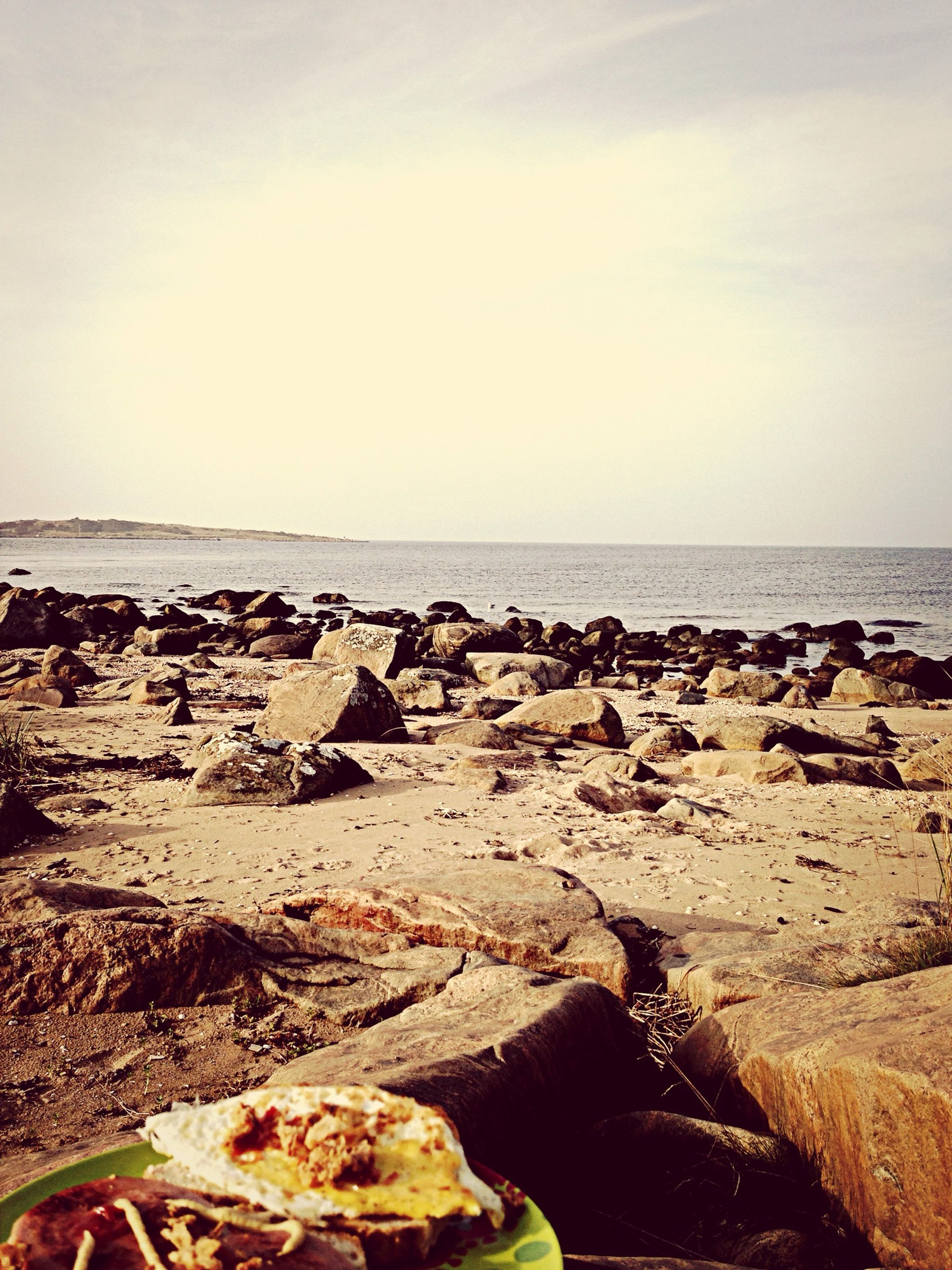 sea, horizon over water, water, beach, shore, scenics, tranquil scene, tranquility, rock - object, beauty in nature, sky, nature, sand, coastline, idyllic, wave, stone - object, rock formation, rock, outdoors