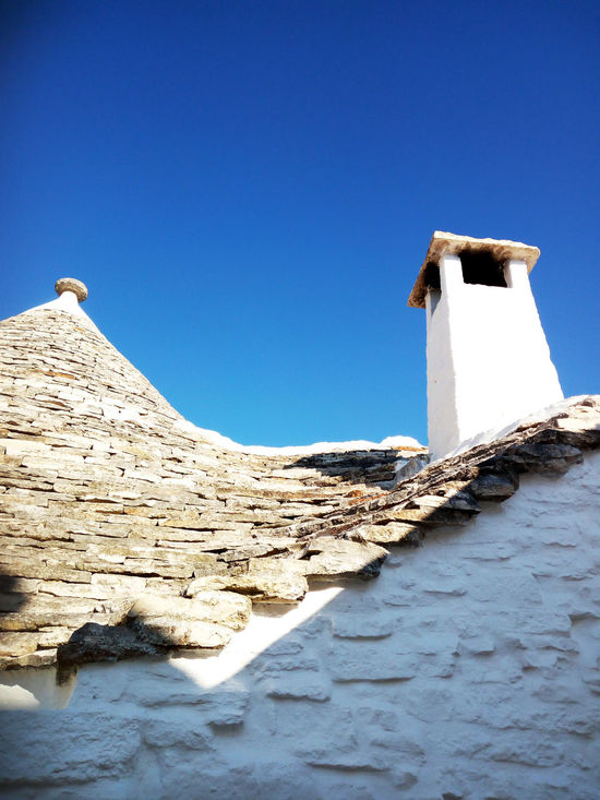 Architecture Blue Building Exterior Built Structure Clear Sky Day Nature No People Outdoors Roof Scenics Stone Material Tranquil Scene Tranquility Trullo Di Albero Bello