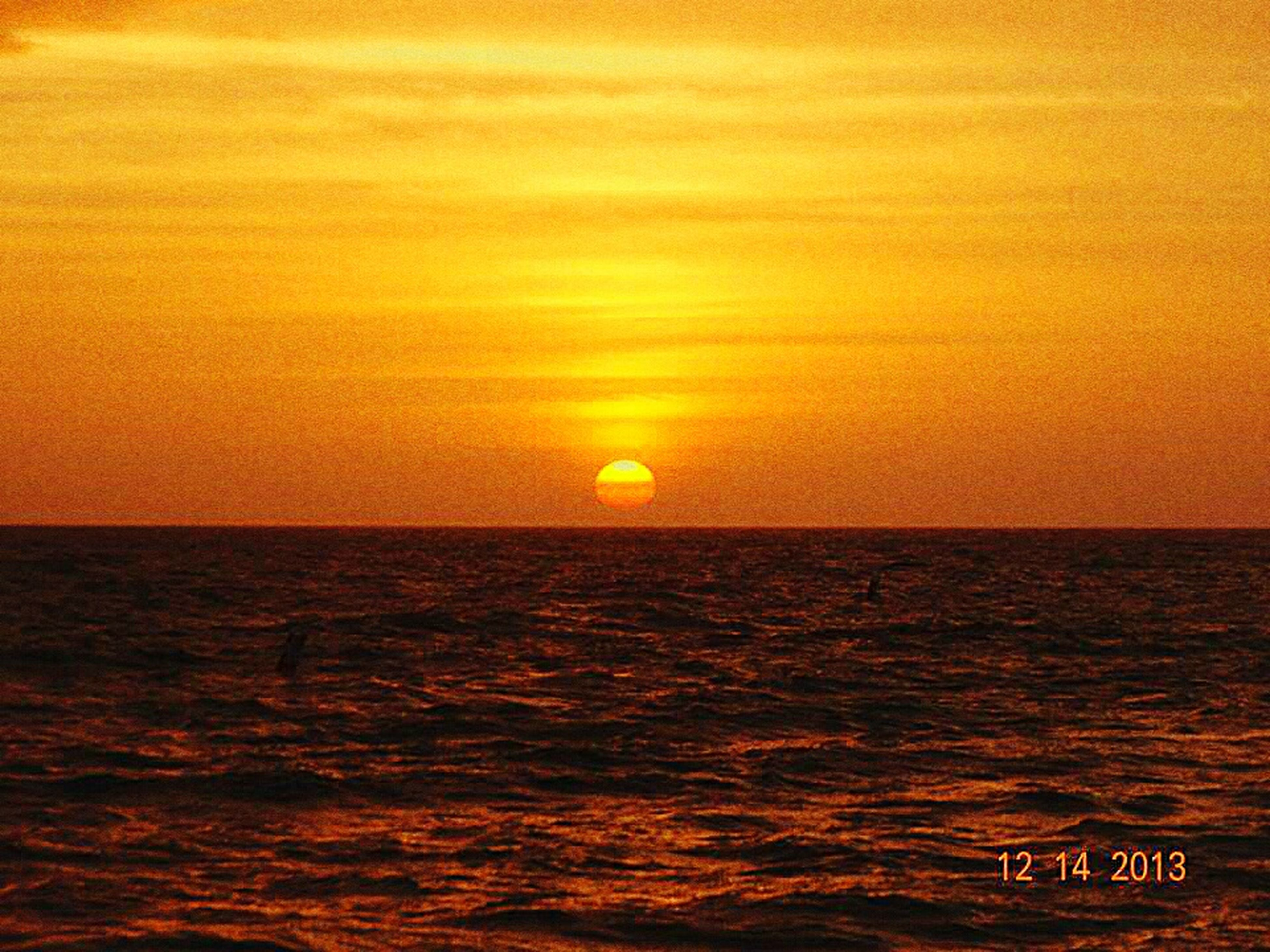 sunset, sea, water, orange color, waterfront, horizon over water, scenics, tranquil scene, beauty in nature, sun, rippled, tranquility, idyllic, nature, sky, seascape, reflection, outdoors, no people, sunlight