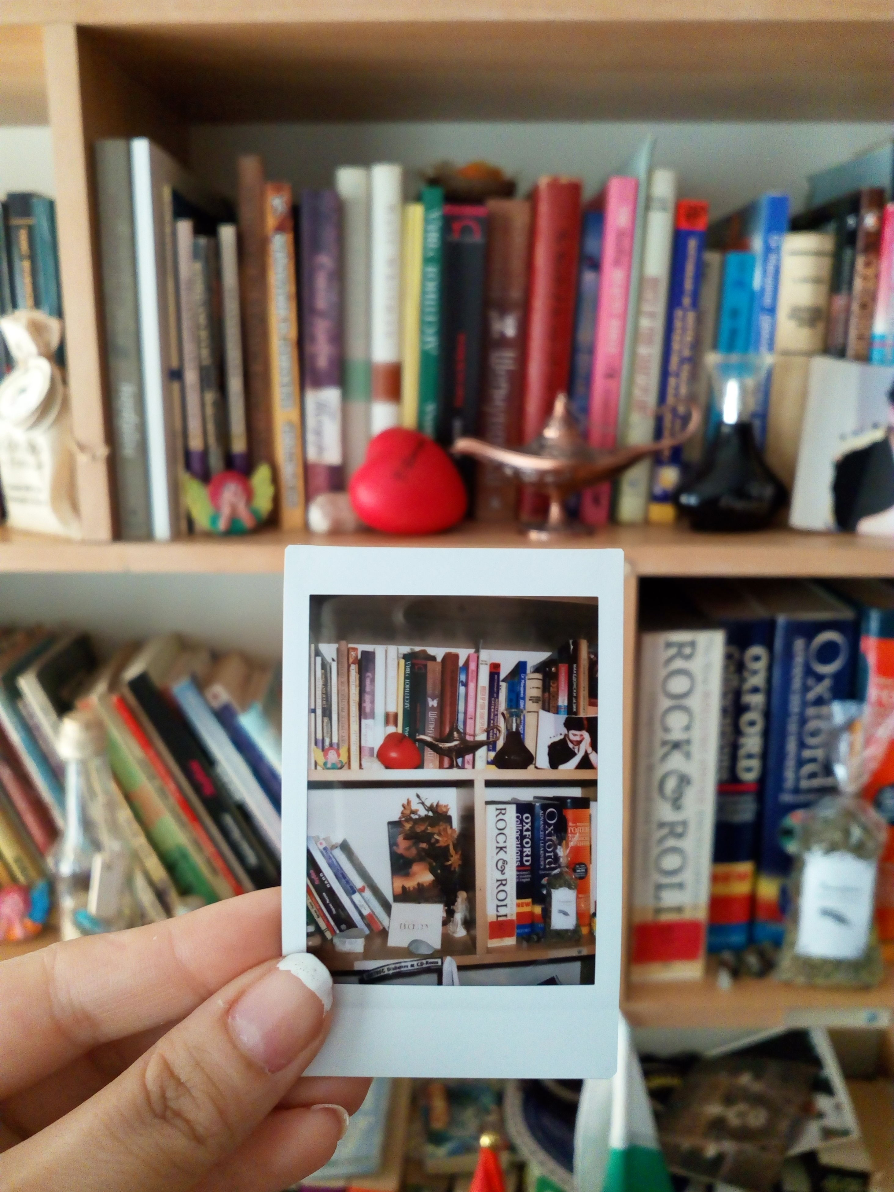 person, indoors, part of, holding, cropped, focus on foreground, unrecognizable person, variation, large group of objects, lifestyles, selective focus, book, human finger, men, choice, abundance, retail