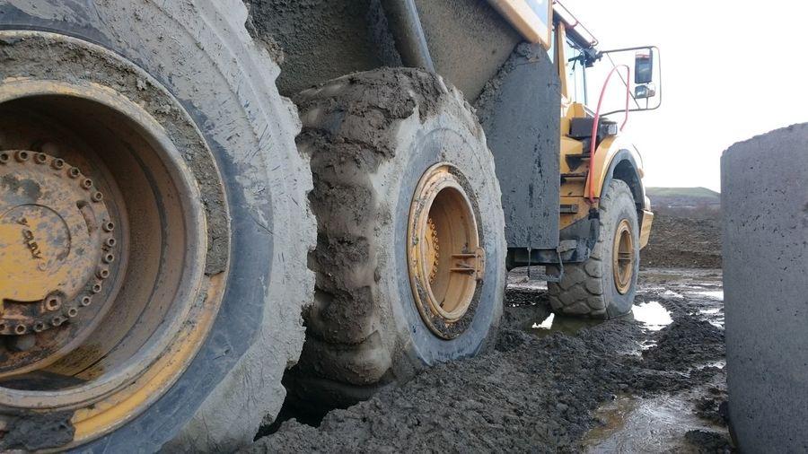 Tire Dirty Wheel Mud Transportation Construction Site Muddy Waters Muddy Water MuddyWater Sinking Feeling Squiddy Wet Muddy Road Construction Machinery Construction Site Construction Industry Construction Vehicle Construction Zone
