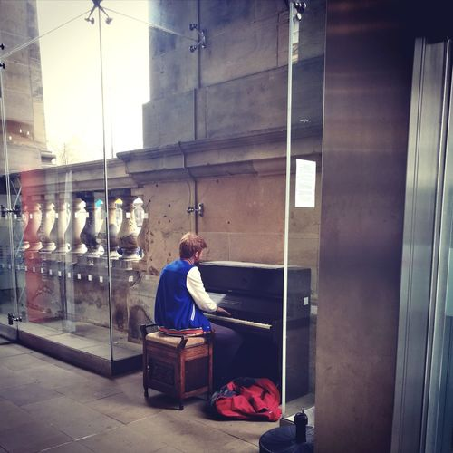 Trainstation Piano One Person One Man Only Adult Sitting Real People Day City Train Station Piano Piano Moments Pianist Public Transportation Public Art Talent Public Places Commute Commuter Musician Music The Street Photographer - 2017 EyeEm Awards