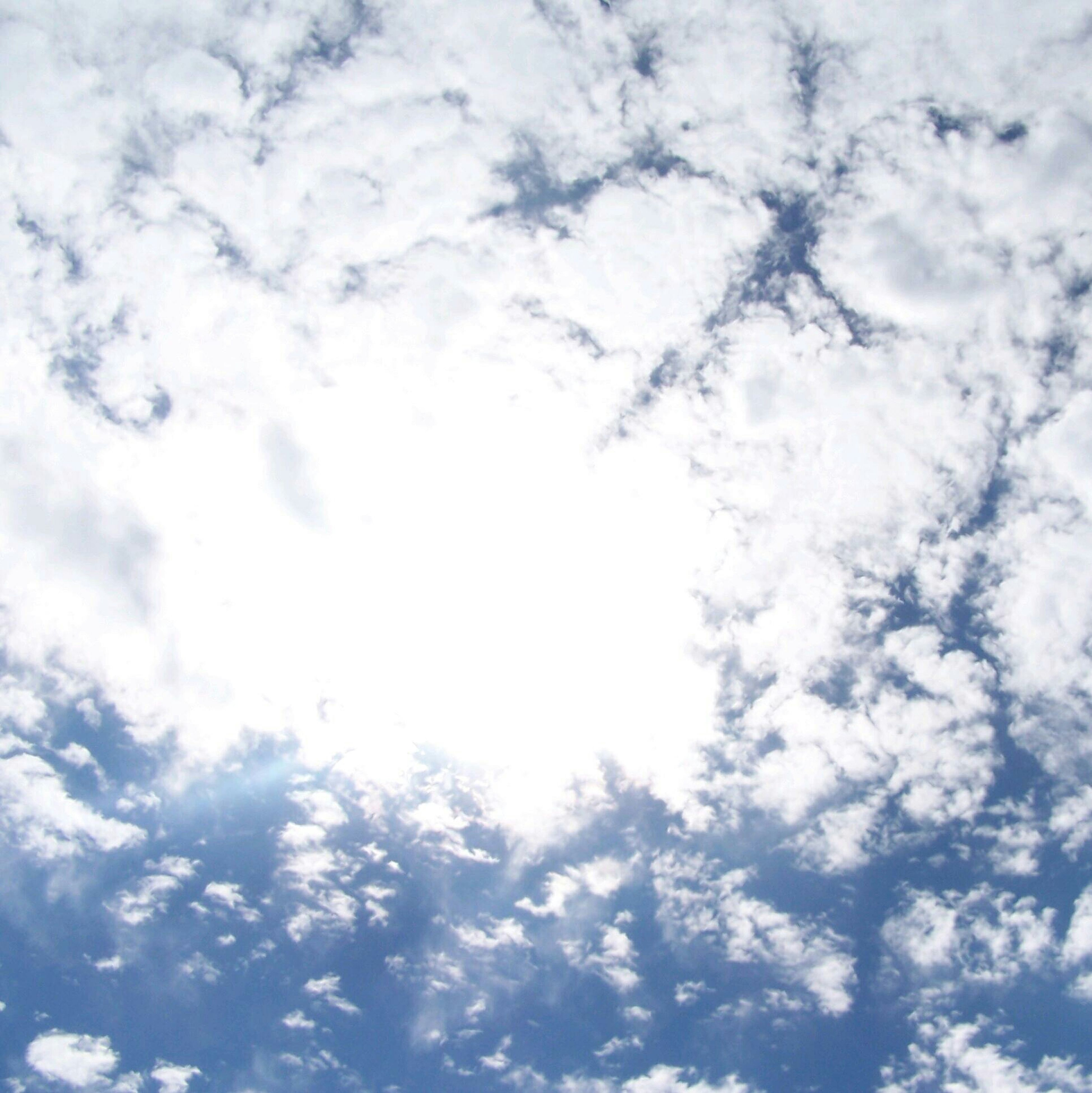 low angle view, sky, cloud - sky, sky only, beauty in nature, backgrounds, tranquility, full frame, nature, cloudy, scenics, tranquil scene, cloudscape, cloud, blue, white color, day, idyllic, outdoors, no people