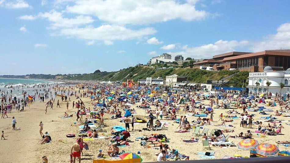 Im sure we'll get a good space.. Quotha Q Showcase March Beach Seaside Bournemouth Croweded Travel Photography Clouds And Sky Sea Sand People Beach People Beach Umbrellas