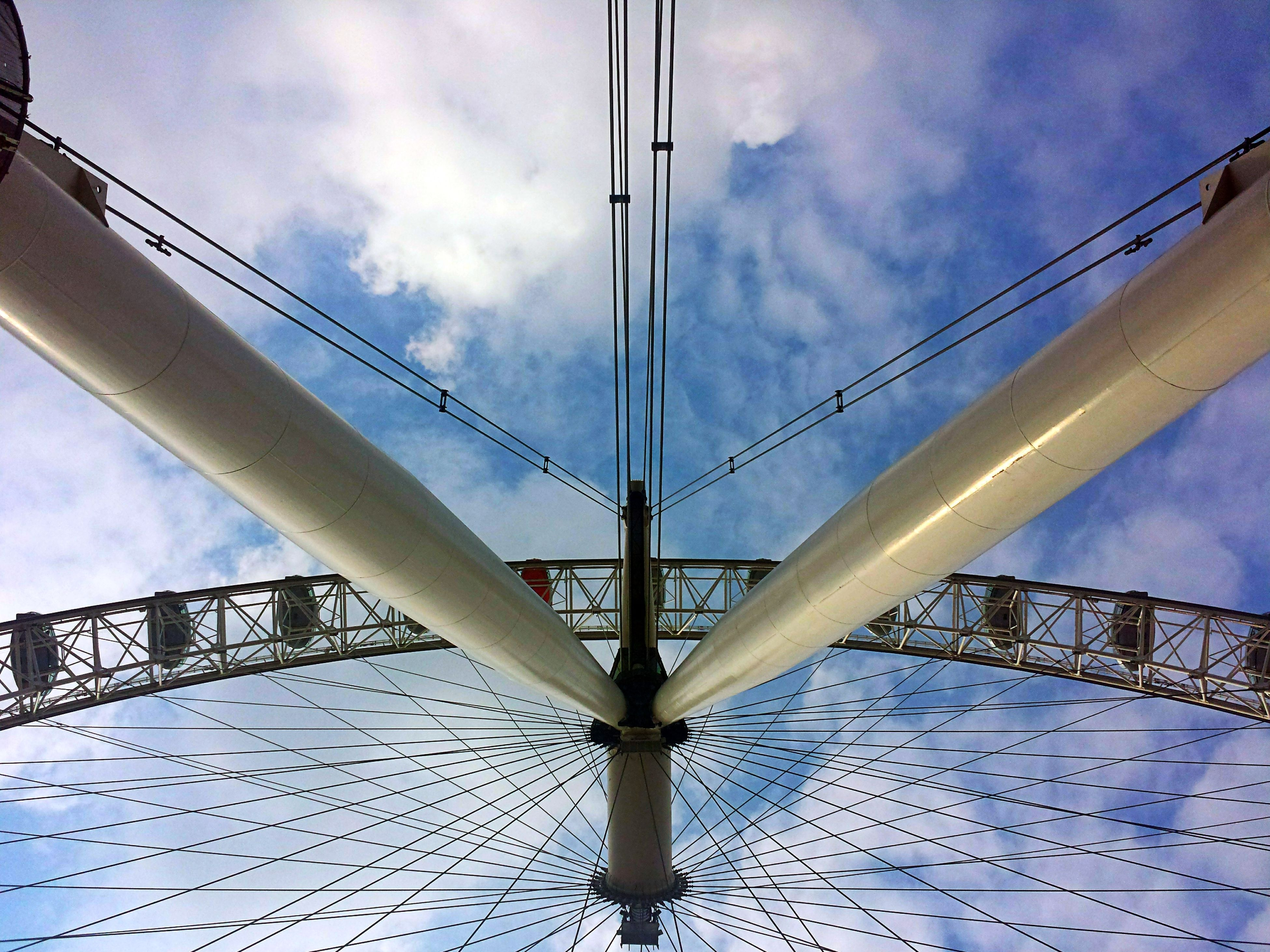 low angle view, connection, sky, engineering, built structure, architecture, bridge - man made structure, cloud - sky, suspension bridge, steel cable, transportation, cloud, cloudy, metal, cable-stayed bridge, cable, bridge, day, famous place, outdoors