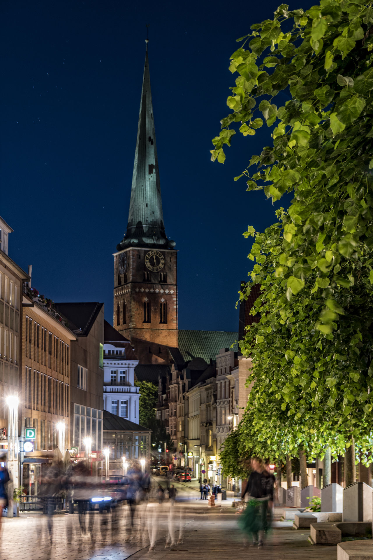 St. Jakobi Kirche Lübeck Architecture Building Exterior Built Structure City Clock Clock Tower Illuminated Large Group Of People Motion Blur Nature Night Outdoors People Place Of Worship Religion Sky St. Jakobi Kirche Zu Lübeck Tree