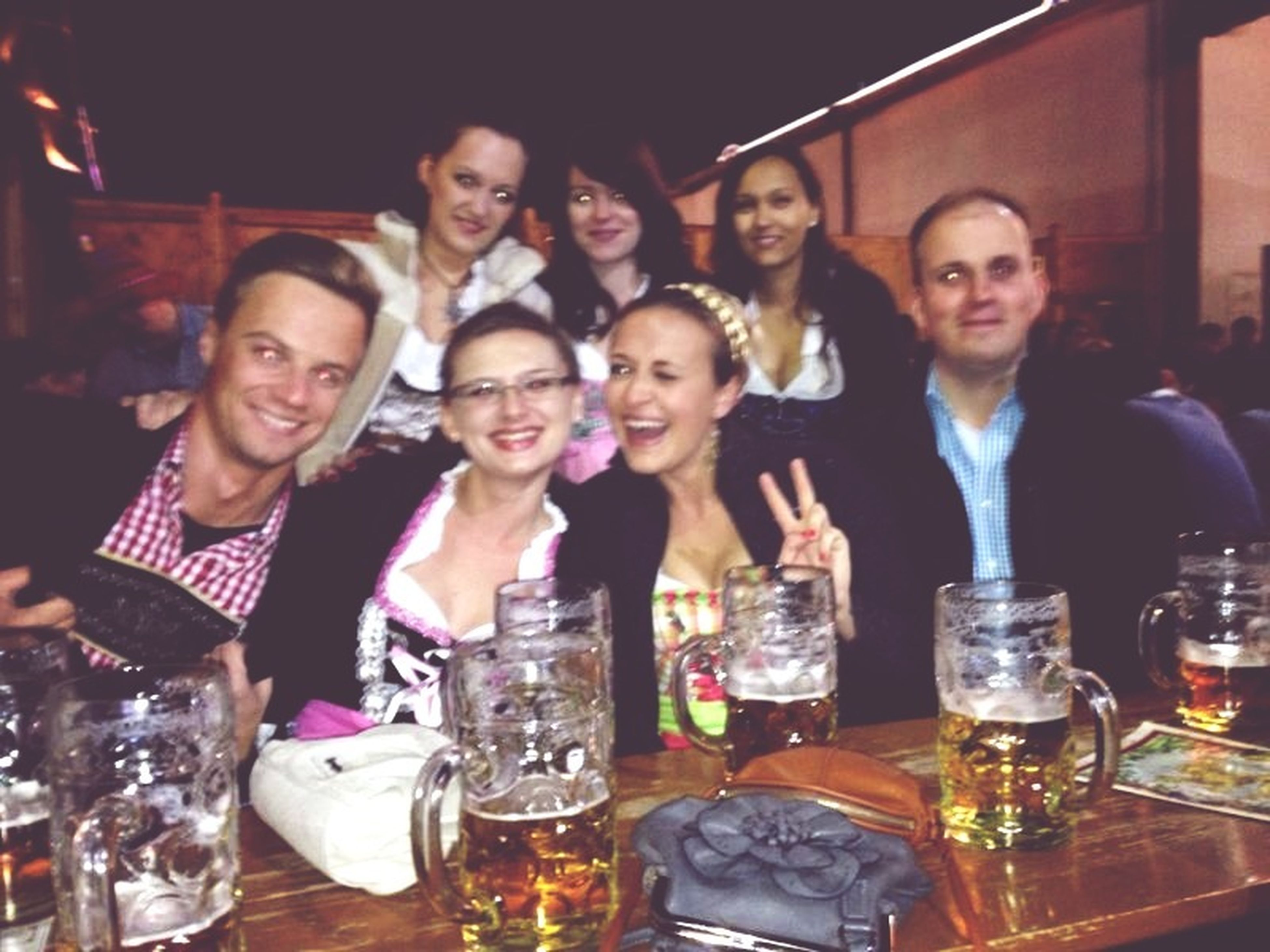 indoors, food and drink, lifestyles, togetherness, drink, leisure activity, restaurant, friendship, front view, table, happiness, bonding, portrait, refreshment, side by side, celebration, person, looking at camera
