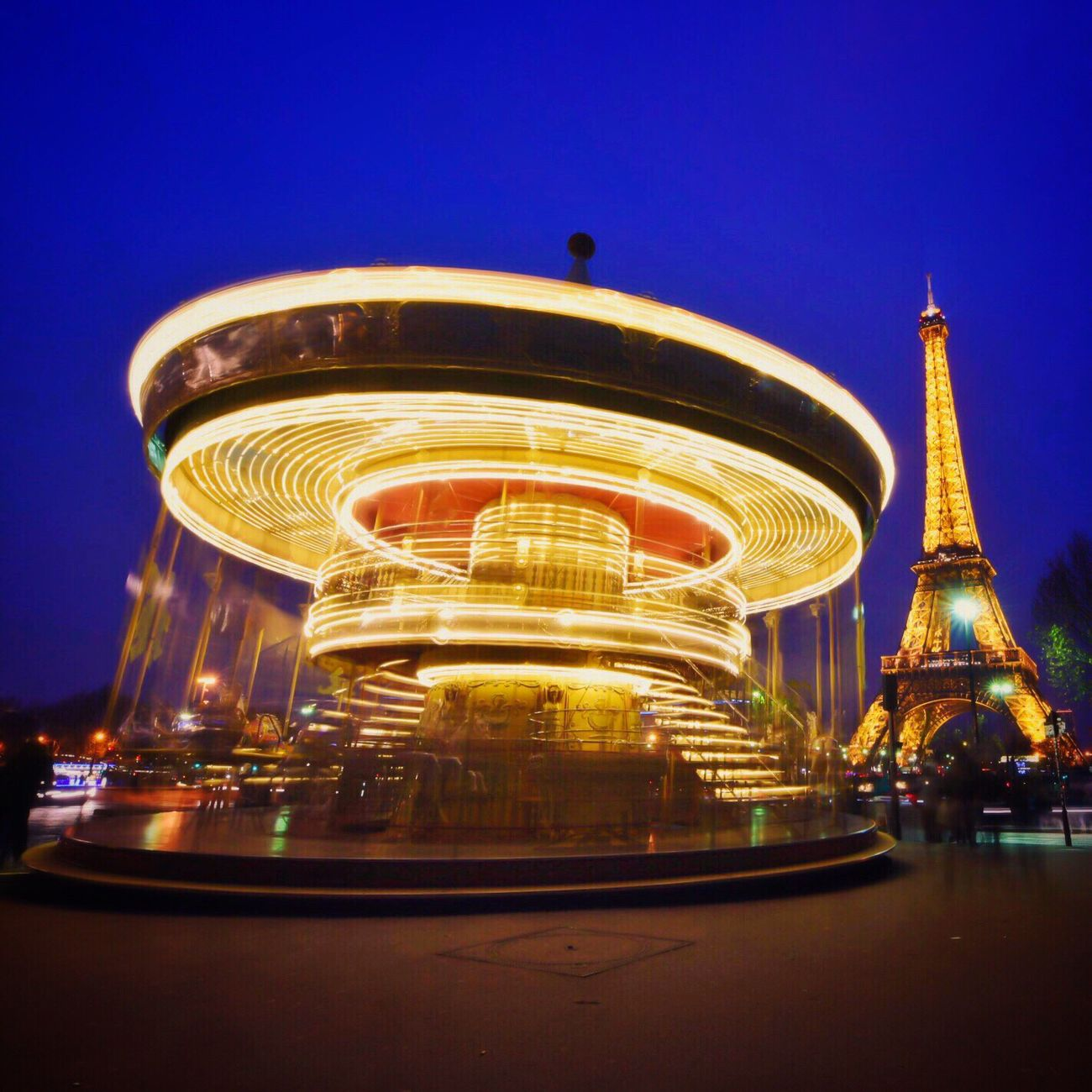 A little color for a grey evening! Bonsoir Paris! Clear Sky Carousel Illuminated Blue Architecture Merry-go-round Paris ❤ Eyem Best Shot - Architecture Amusement Park Ride Parisweloveyou EyeEm Best Shots Paris Photooftheday