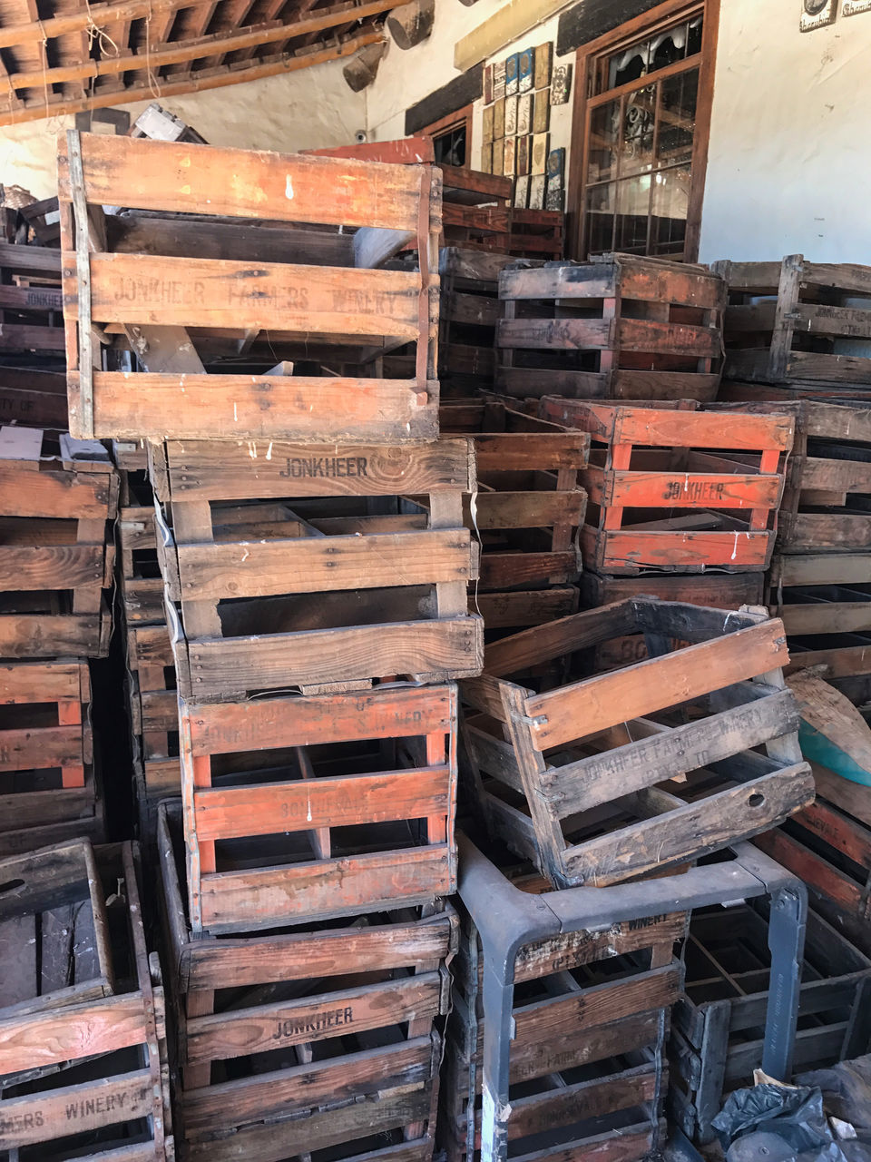 stack, wood - material, abundance, large group of objects, arrangement, shelf, no people, indoors, warehouse, day, seat, wine cask