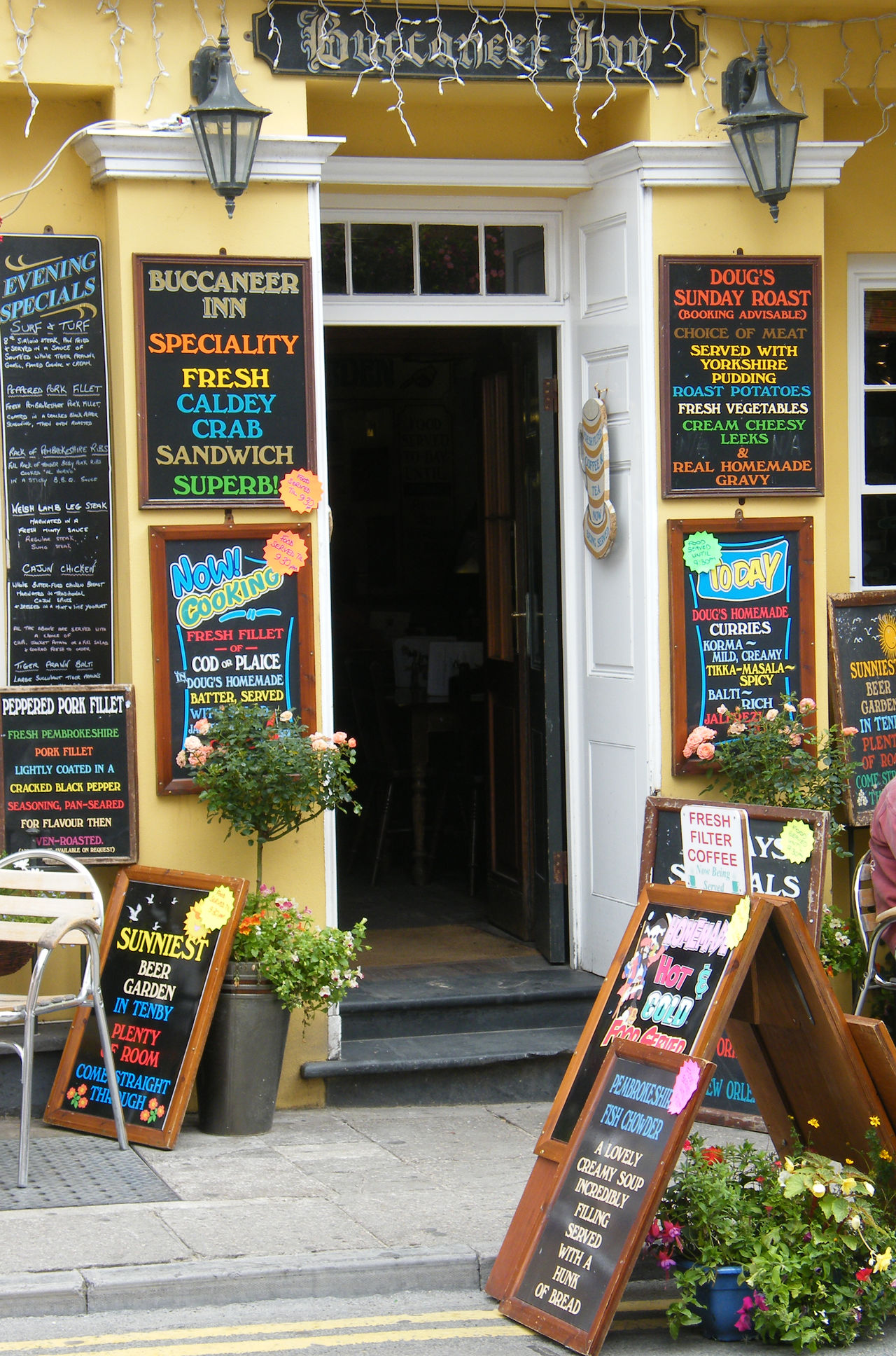 Blackboard  Business Finance And Industry Consumerism Day Flower No People Outdoors Pembrokeshire Pembrokeshire Coast Pembrokeshire Coastal Path Pub Public House Retail  Seaside Town Store Tenby Text