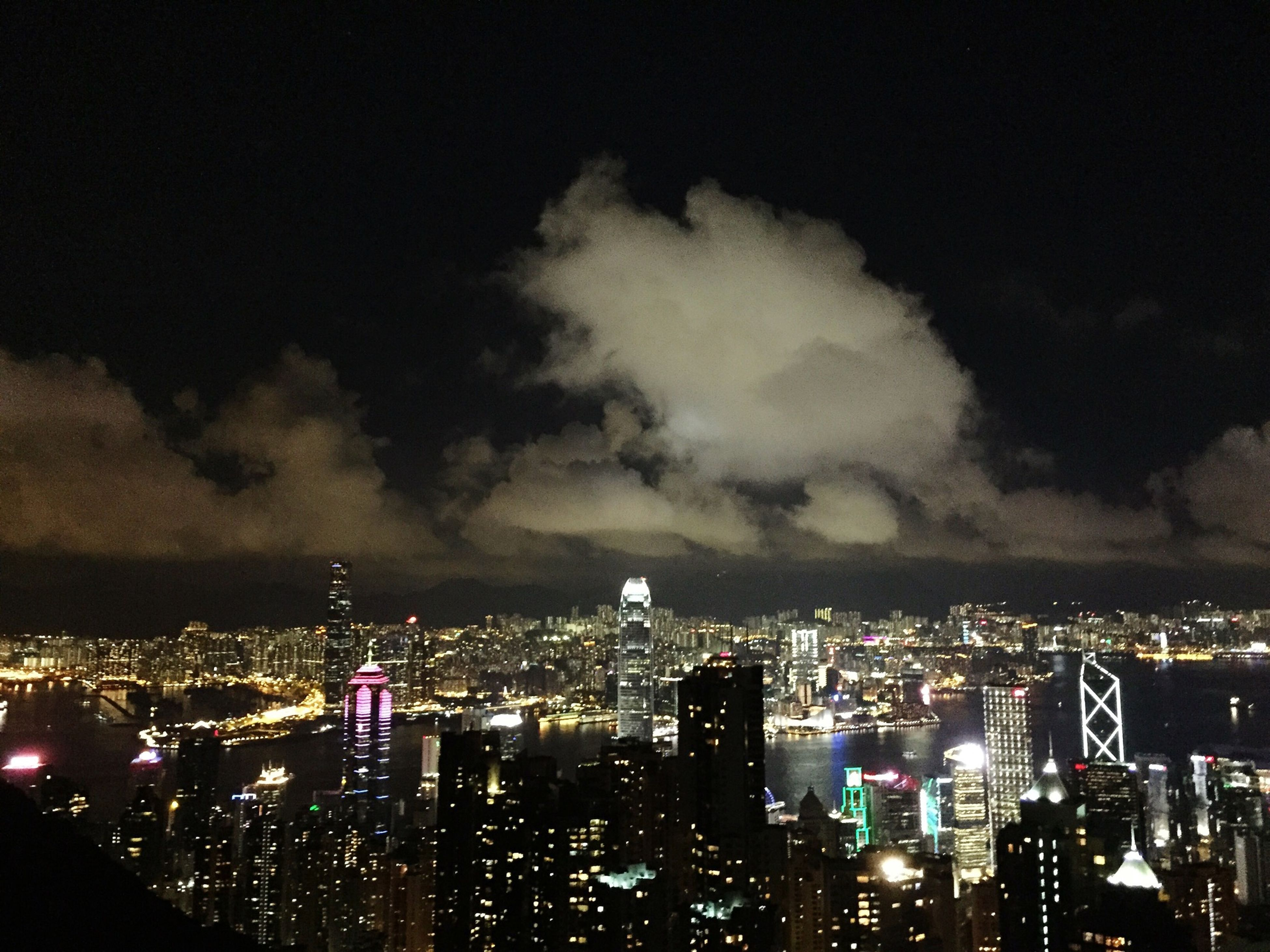 cityscape, city, illuminated, building exterior, night, architecture, built structure, skyscraper, sky, crowded, modern, urban skyline, tall - high, tower, office building, cloud - sky, residential district, financial district, development, residential building
