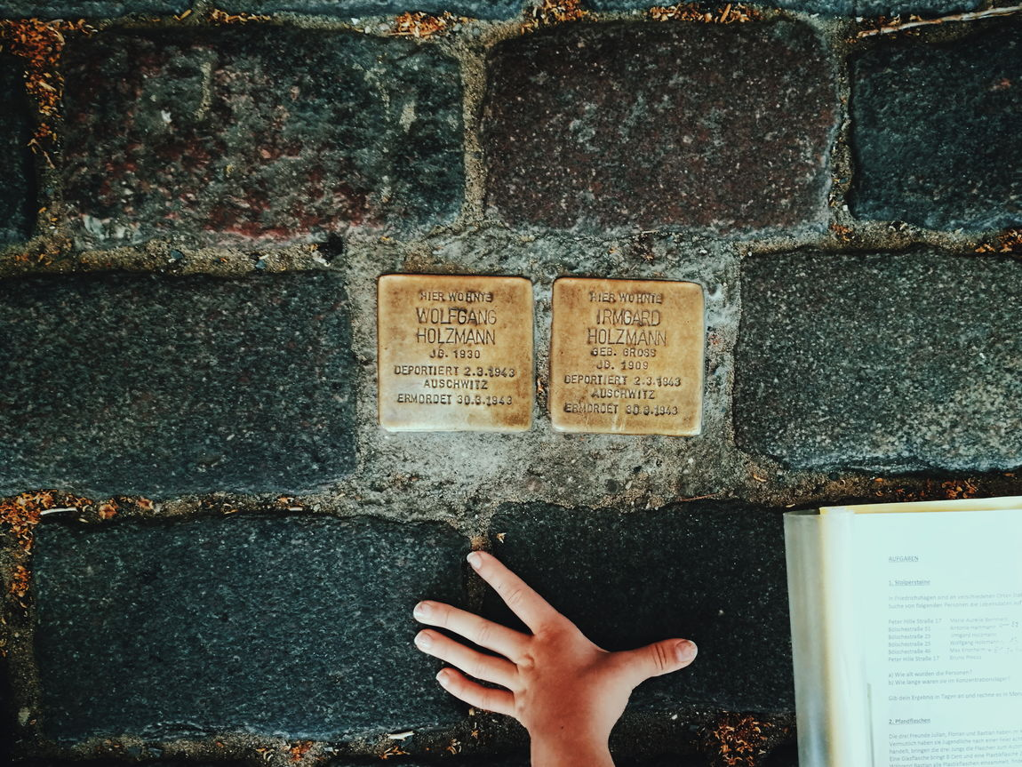 Homework... One Person Human Body Part Human Hand Text Close-up Stolpersteine Holocaust Memorial Holocaust Remembrance Holocaust Ww2 Cobblestone