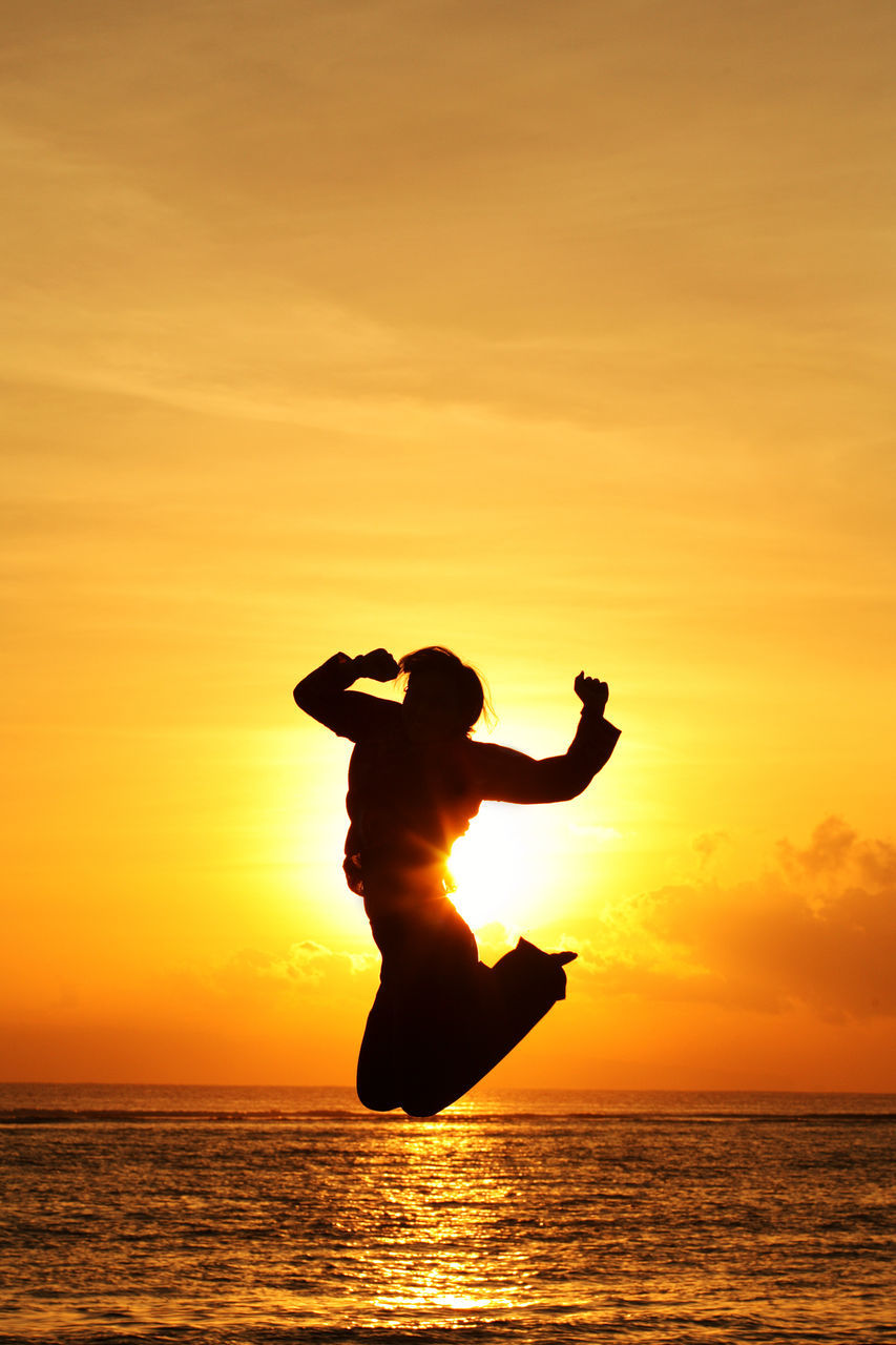 sunset, silhouette, orange color, sea, water, sun, horizon over water, full length, sky, jumping, beauty in nature, nature, scenics, one person, real people, leisure activity, beach, outdoors, men, lifestyles, enjoyment, excitement, vacations, energetic, people
