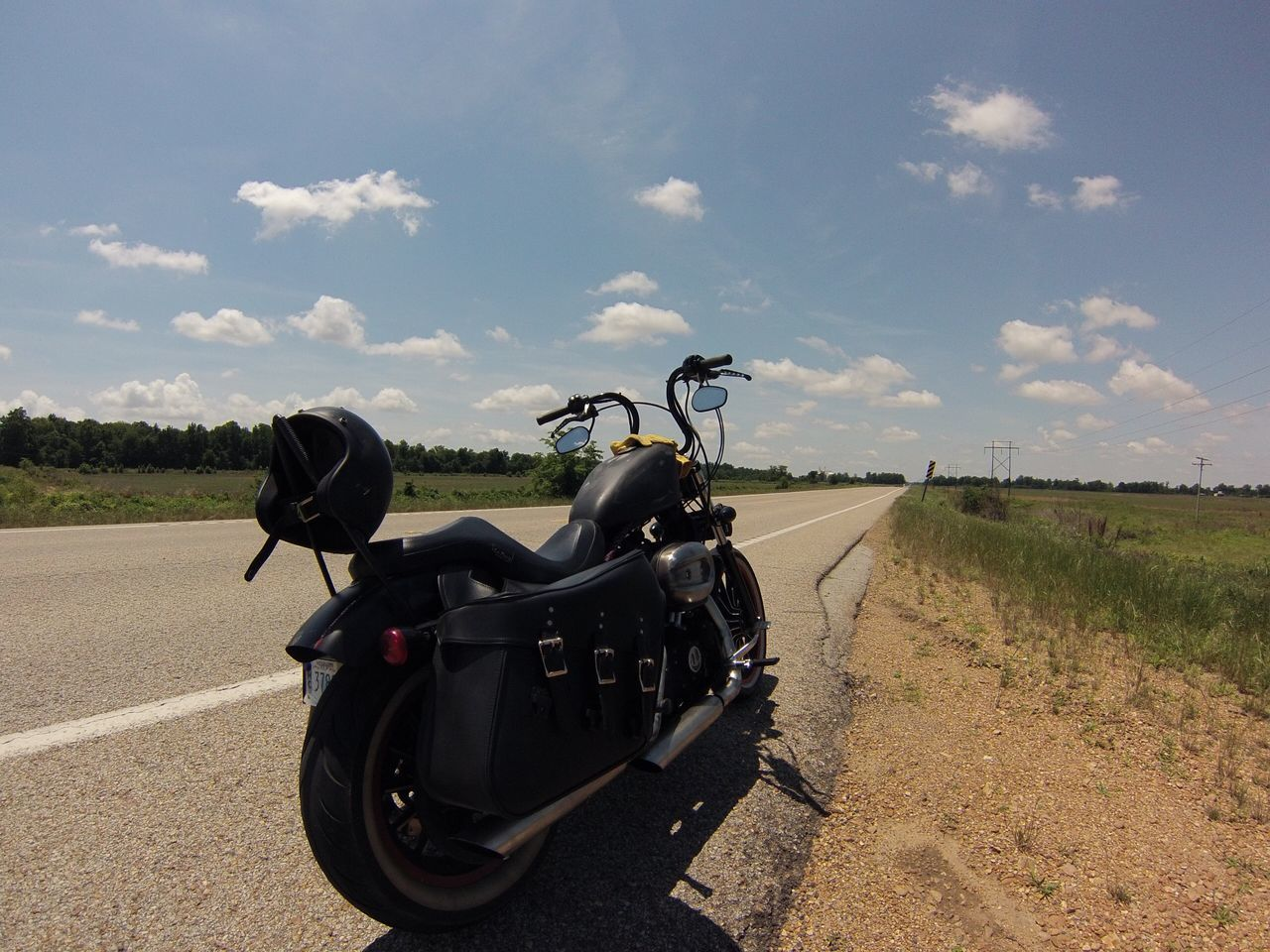 road, transportation, sky, day, field, cloud - sky, landscape, grass, outdoors, motorcycle, land vehicle, nature, no people, beauty in nature