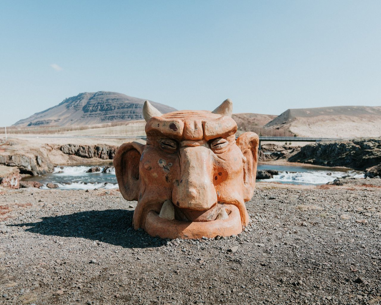 Troll head statue in Iceland No People Day Outdoors Sculpture Mountain Ancient Civilization Troll Iceland Face Folklore Statue Elf Waterfall Mountains