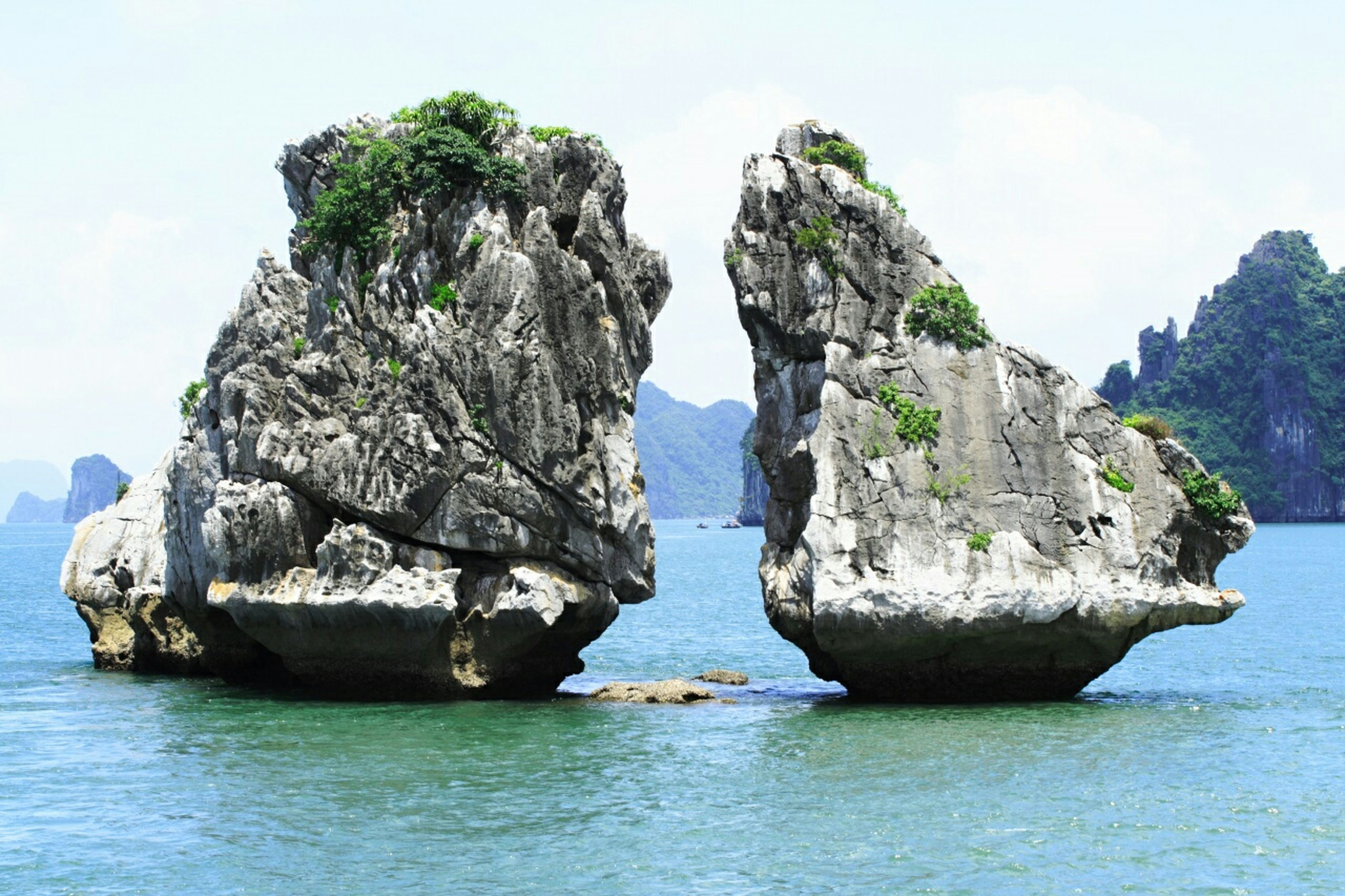 water, sea, nautical vessel, boat, transportation, rock - object, tranquility, rock formation, waterfront, sky, tranquil scene, scenics, mode of transport, beauty in nature, nature, horizon over water, rock, cliff, day, idyllic