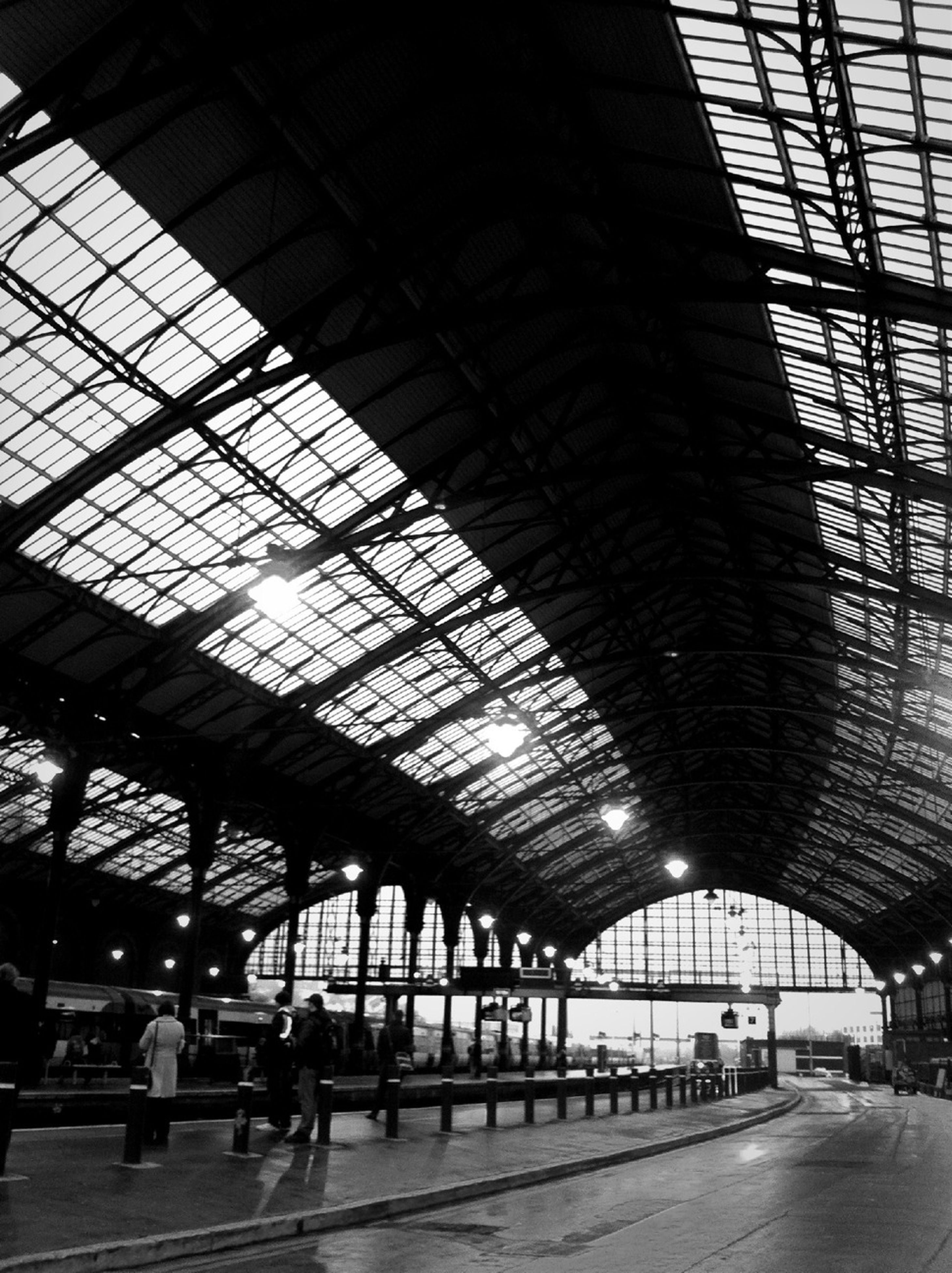 transportation, indoors, railroad station, railroad station platform, ceiling, public transportation, built structure, architecture, illuminated, rail transportation, transportation building - type of building, incidental people, mode of transport, airport, travel, subway station, railroad track, city life, train - vehicle