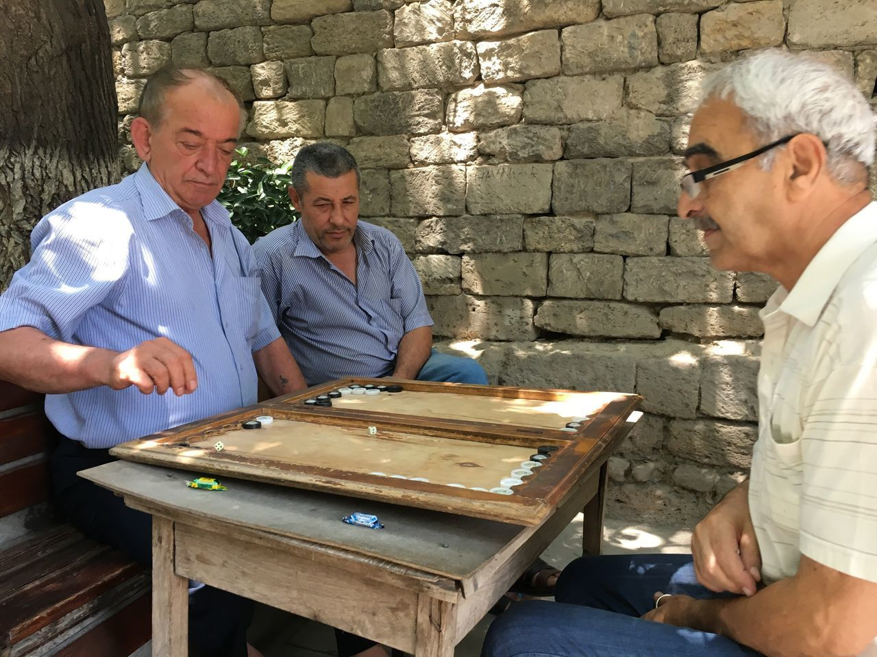 Men play a game of Backgammon in Baku's Old City in Azerbaijan Daily Life Traveling Azerbaijan Baku Life