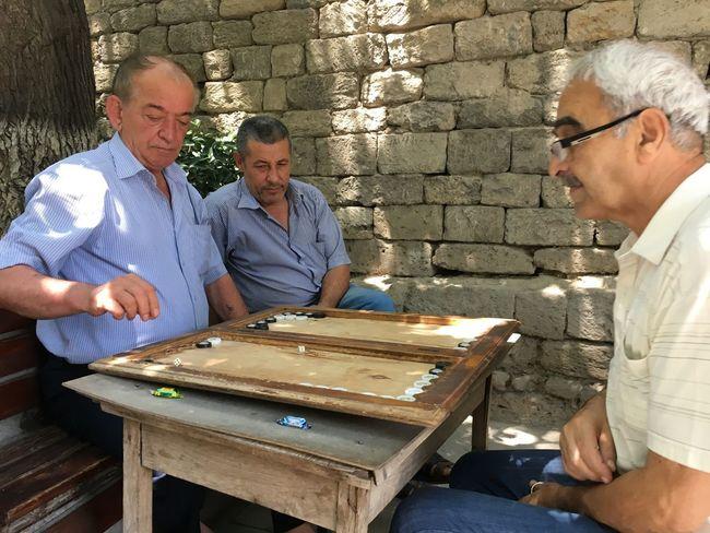 Men play a game of Backgammon in Baku's Old City in Azerbaijan Daily Life Traveling Azerbaijan Baku Life