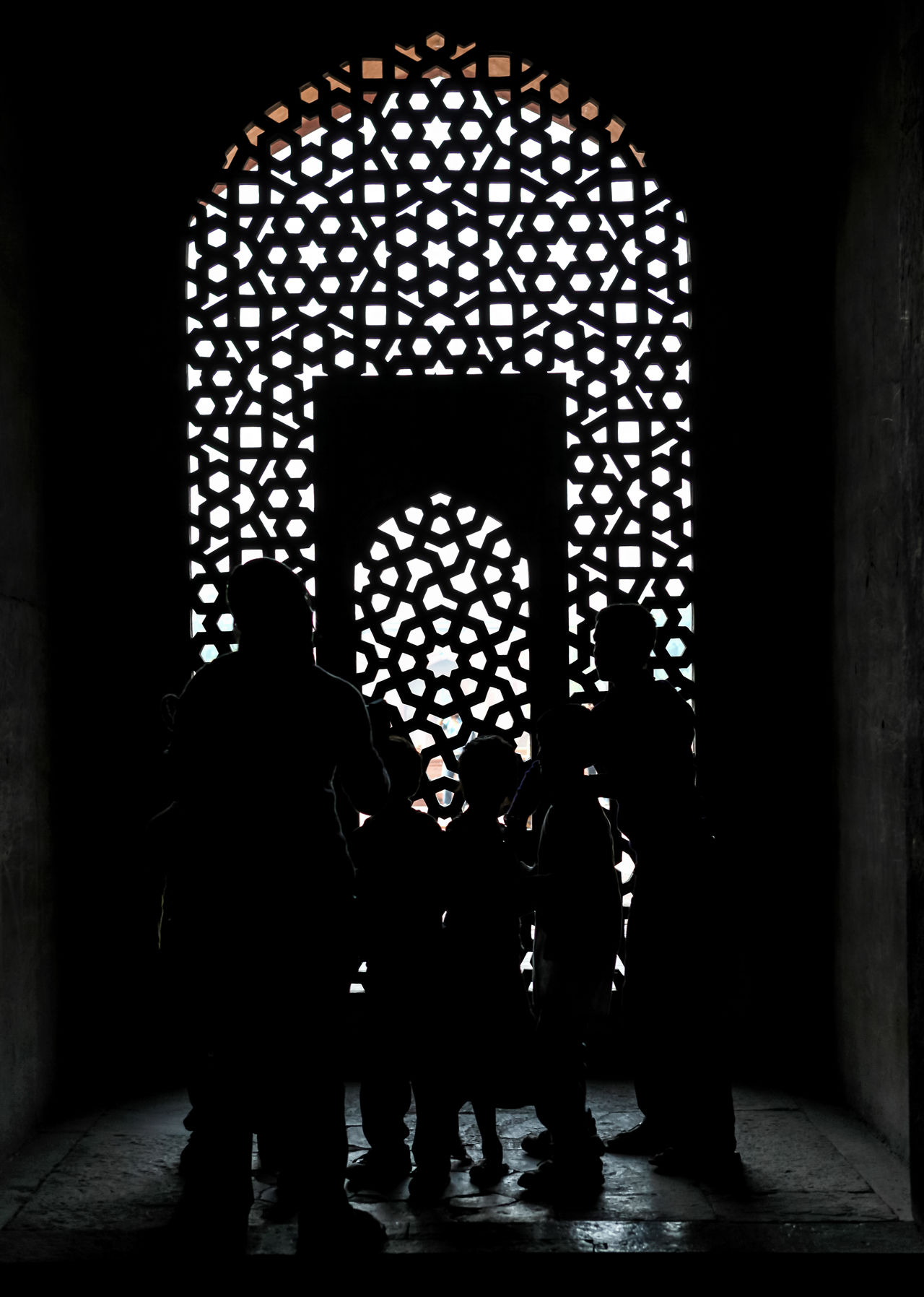 Silhouette Indoors  Window Standing Real People Only Men Men People Adults Only Adult Day Architecture Grid Design Full Frame Jali Indoors  Craft Stone Craftmanship Geometric Geometric Shapes India HumayunTomb Architectural