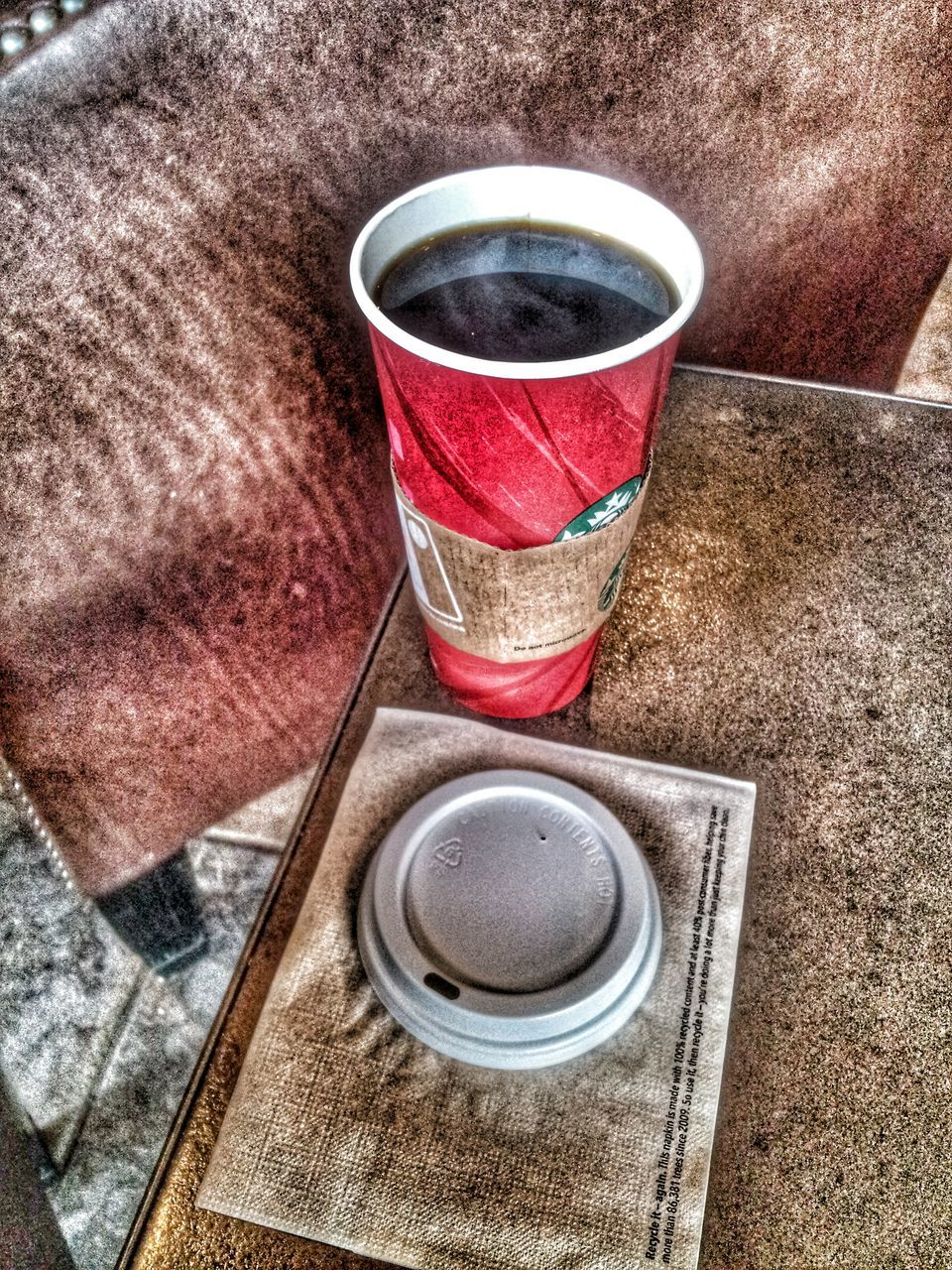 Close-Up Of Disposable Cup And Lid