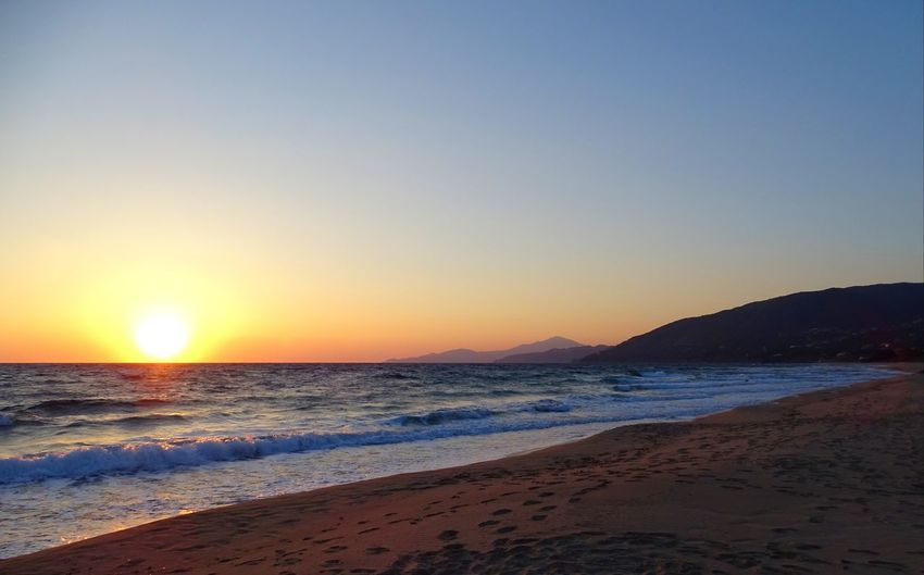 Beach Beauty In Nature Clear Sky Day Horizon Over Water Nature No People Outdoors Sand Scenics Sea Shore Sky Sun Sunlight Sunset Tranquil Scene Tranquility Water Wave