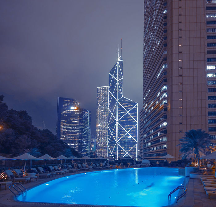 Night view over the pool of Shangri-La Hotel in Hong Kong and a legendary Bank of China building. Bank Of China China City Lights Cityscape Hong Kong Hotel Luxury Luxurylifestyle  Pool Summer Sunset Vacation