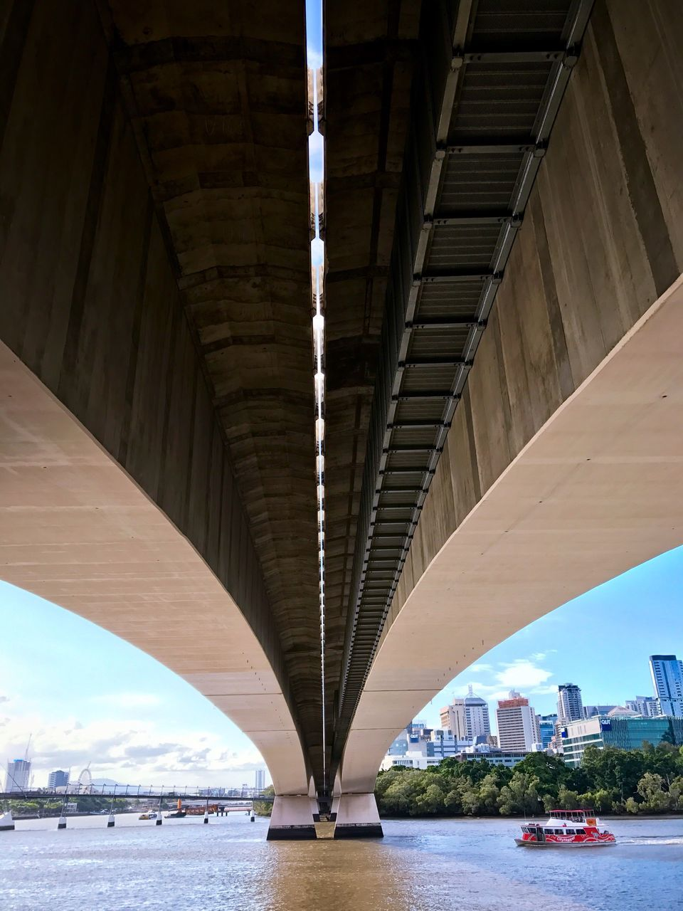 bridge - man made structure, connection, architecture, transportation, engineering, built structure, below, river, underneath, bridge, arch, water, under, day, waterfront, outdoors, city, covered bridge, road, no people