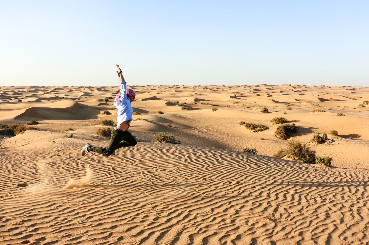 Jump the Desert Adventure Desert Dubai Heat - Temperature Jump Junping Landscape Males  Motion Moving Moving Up One Person Outdoors Sand Sand Dune Sun Sunlight Travel