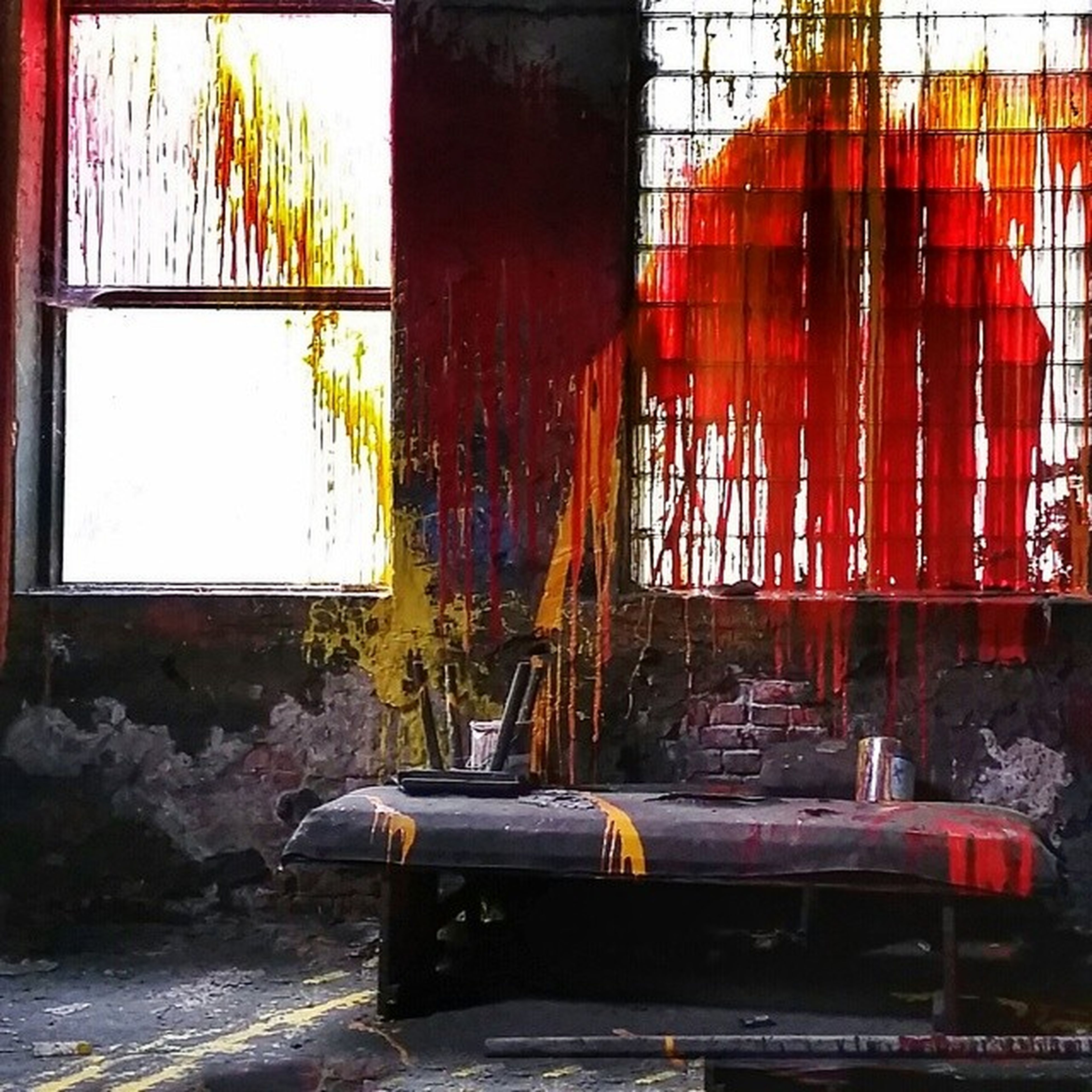 architecture, built structure, building exterior, window, transfer print, auto post production filter, abandoned, glass - material, graffiti, wall - building feature, damaged, day, chair, obsolete, indoors, city, building, absence, sunlight, no people
