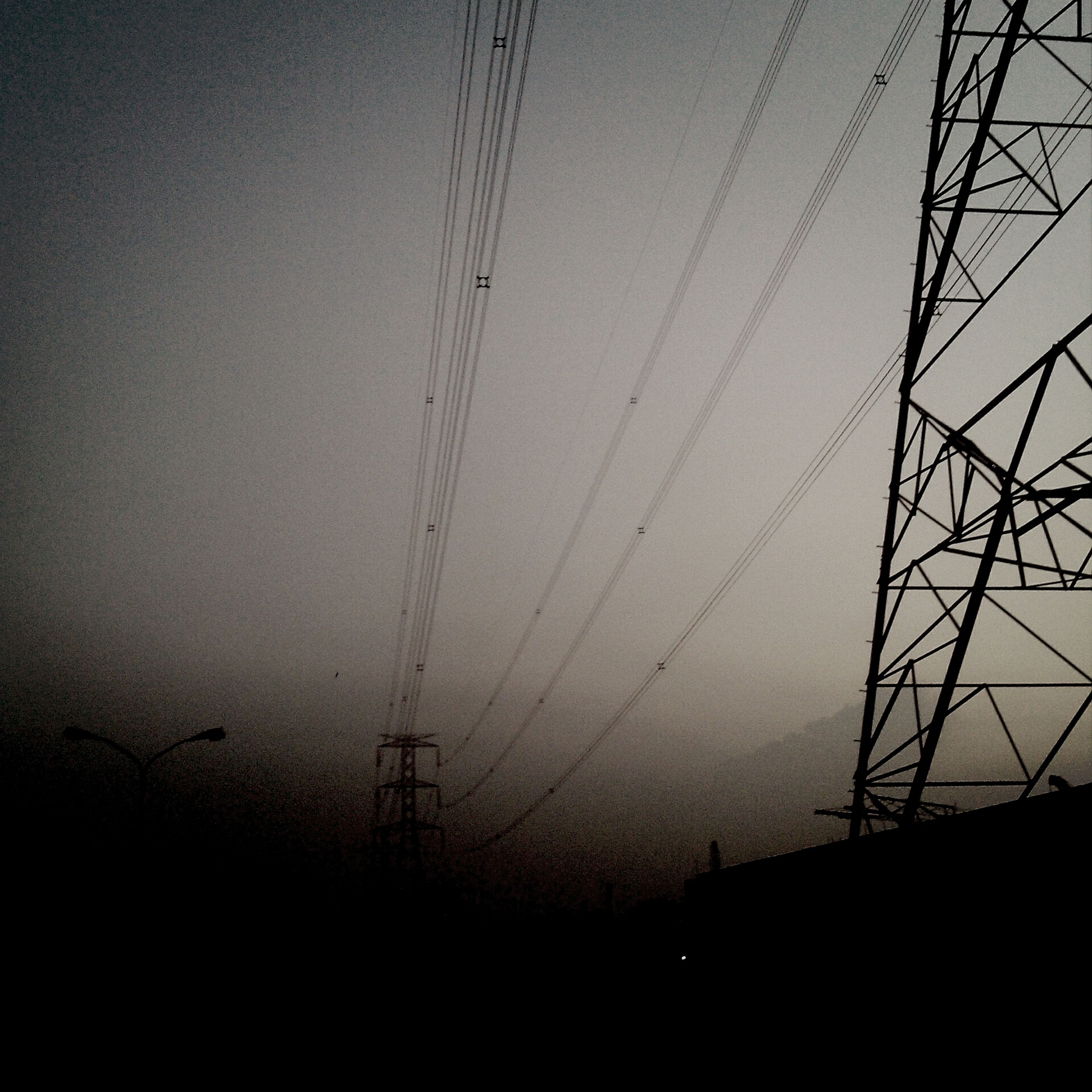 power line, electricity pylon, electricity, power supply, connection, silhouette, low angle view, fuel and power generation, technology, cable, sky, dusk, sunset, clear sky, nature, tranquility, power cable, outdoors, complexity, no people