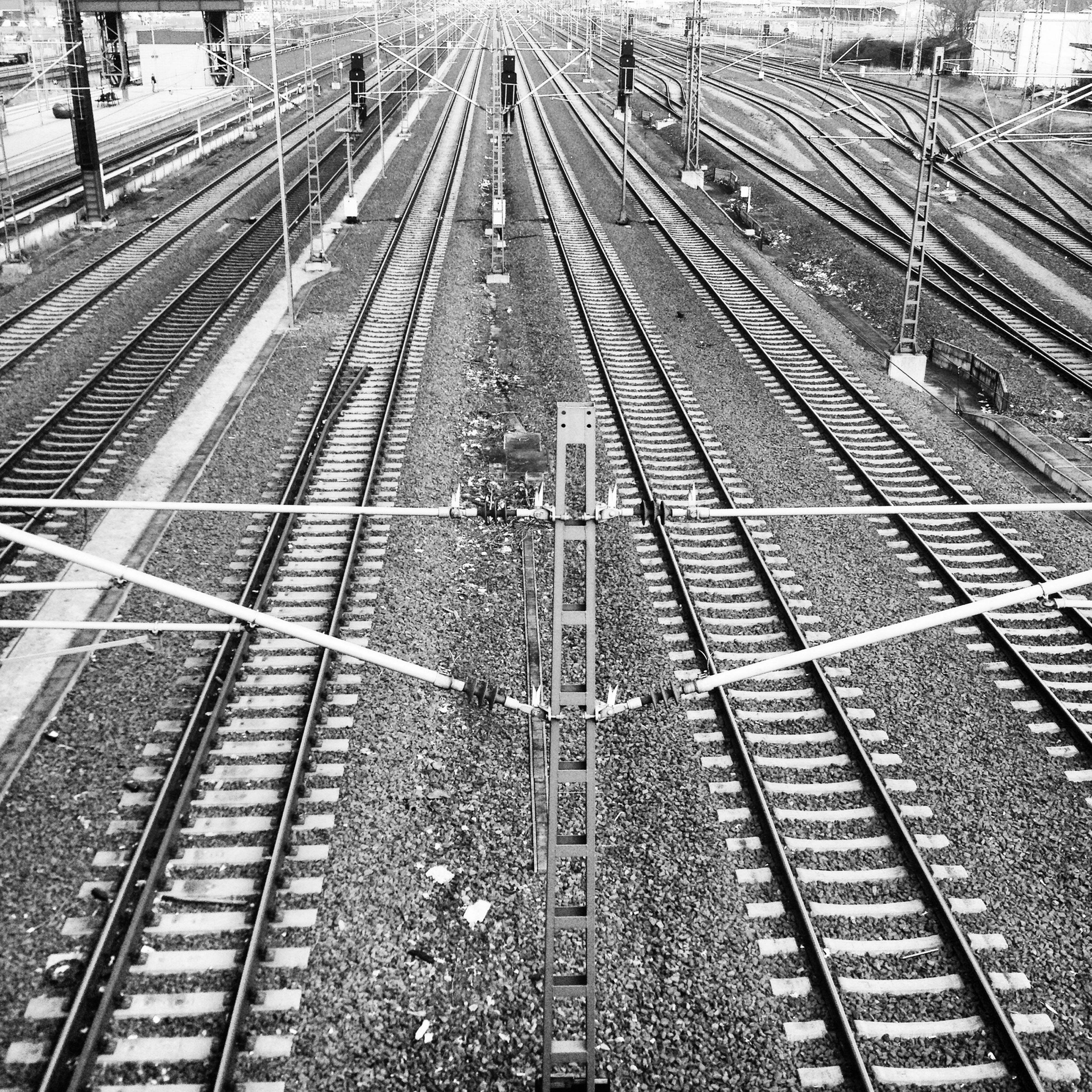 railroad track, transportation, rail transportation, diminishing perspective, the way forward, vanishing point, high angle view, public transportation, railroad station, railroad station platform, railway track, travel, built structure, day, straight, outdoors, architecture, city, mode of transport, train track