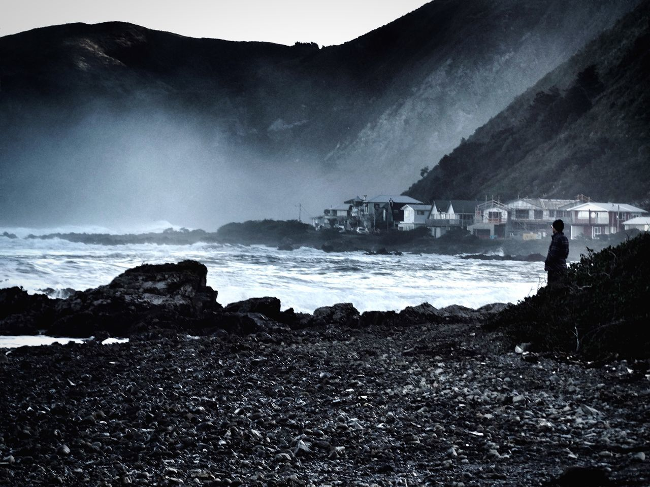 Shades Of Grey Seascape Photography Sea Mist Cliffs Rocks People Man watching the waves and mist. South Coast, Wellington. Newzealandnatural Landscape_photography Newzealandphotography Landscapes With WhiteWall Telling Stories Differently Wellington Nz Owhiro Bay