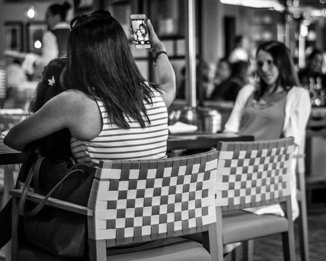 Selfie on a holiday Adult Adults Only Black And White Cafe Chair Day Focus On Foreground Friendship Indoors  Leisure Activity Lifestyles One Person People Real People Reastaurant Selfie Sitting Women Young Adult Young Women