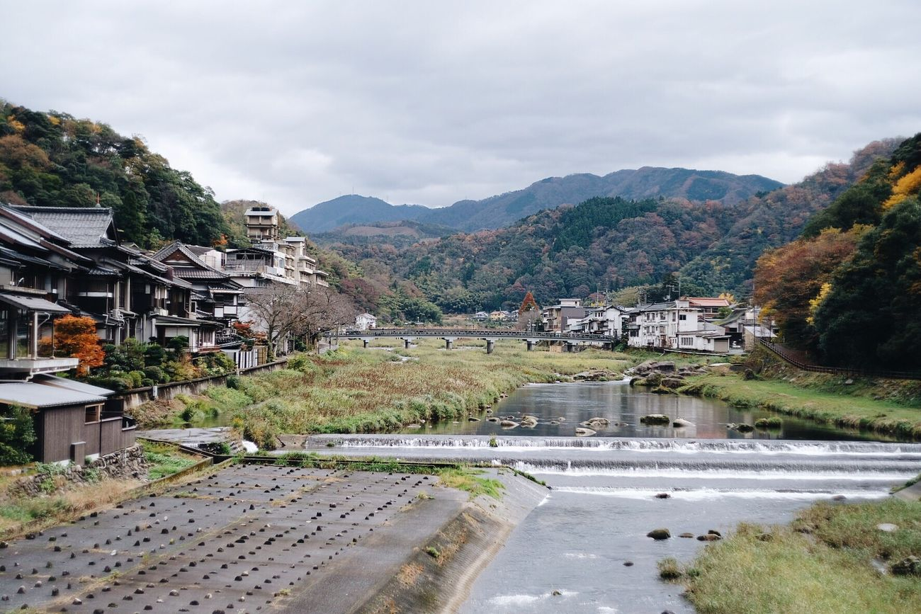 Misasa onsen Water Mountain Architecture Built Structure Sky Building Exterior Nature Mountain Range House Beauty In Nature Tree Outdoors No People Scenics Day Japan Onsen
