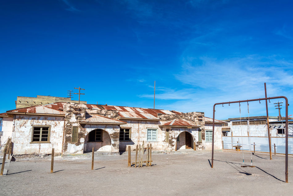 Schoolyard in the ghost town of Humberstone, Chile Architecture Building Chile Dust Factory Heritage Humberstone Industrial Iquique Landscape Nitre No People Old Outdoors Salitrera Saltpeter Saltpetre Sand Santa Laura Site Sunny Town UNESCO World Heritage Site Village Works