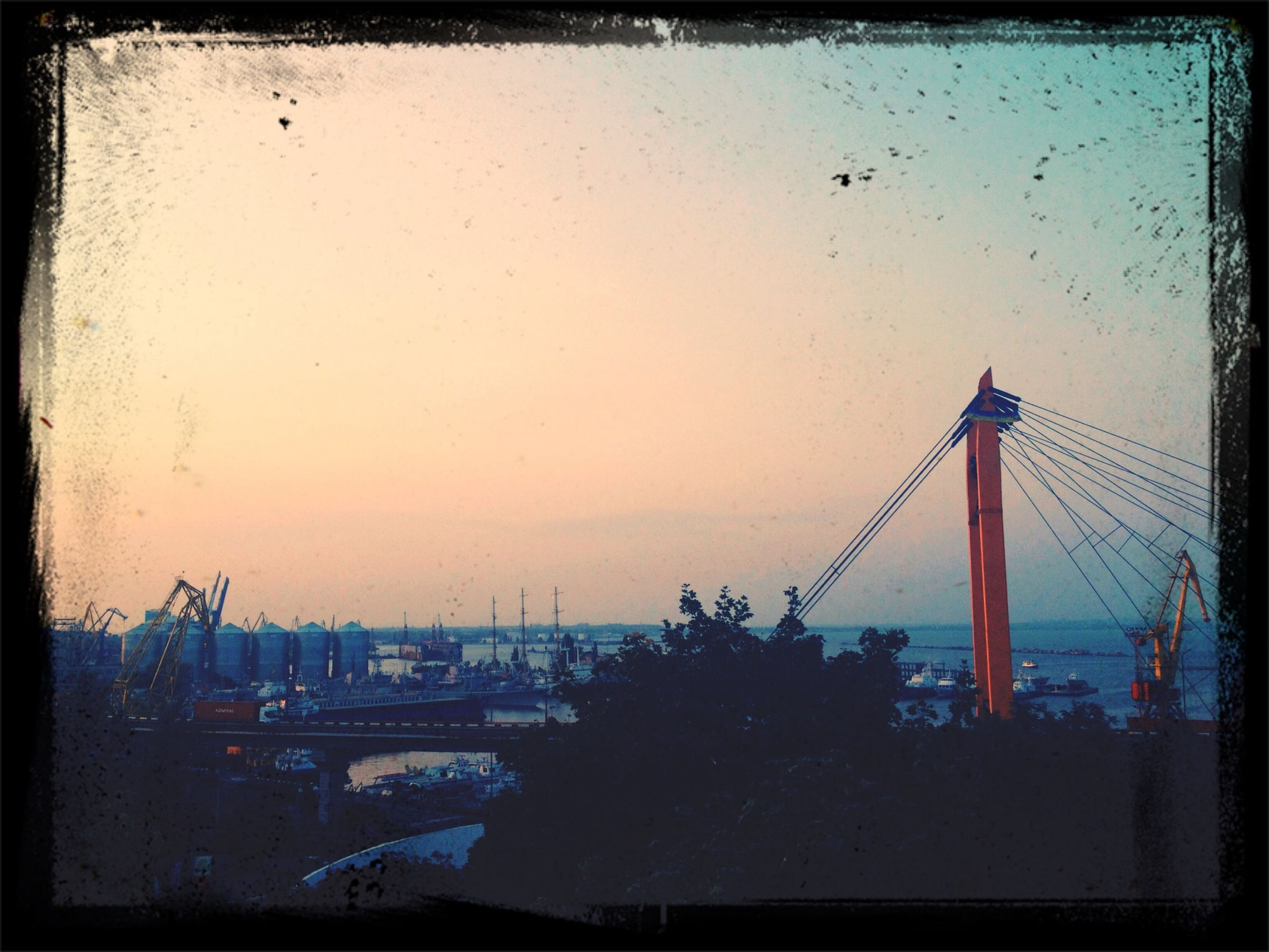architecture, built structure, transfer print, building exterior, water, auto post production filter, city, cityscape, sea, sky, river, connection, bridge - man made structure, clear sky, travel destinations, dusk, sunset, copy space, tower, outdoors