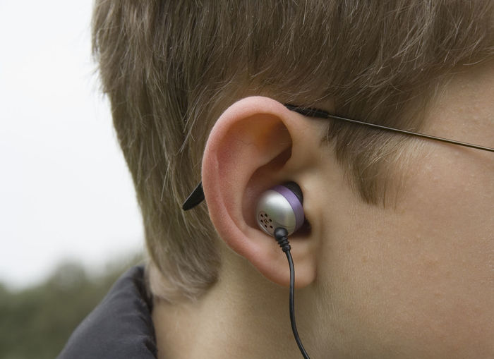 teenagerear with canalphones - risk of hearing-loss Boy Canal Canalphones Close-up Deafness Ear Earbuds Earphones Headphones Headshot Hearingloss High Volume Human Body Part In-ear In-ear Headphones InEarHeadphones Koss Listening Listening To Music Loud Mp3 Music Teen Teenage Boy Teenager
