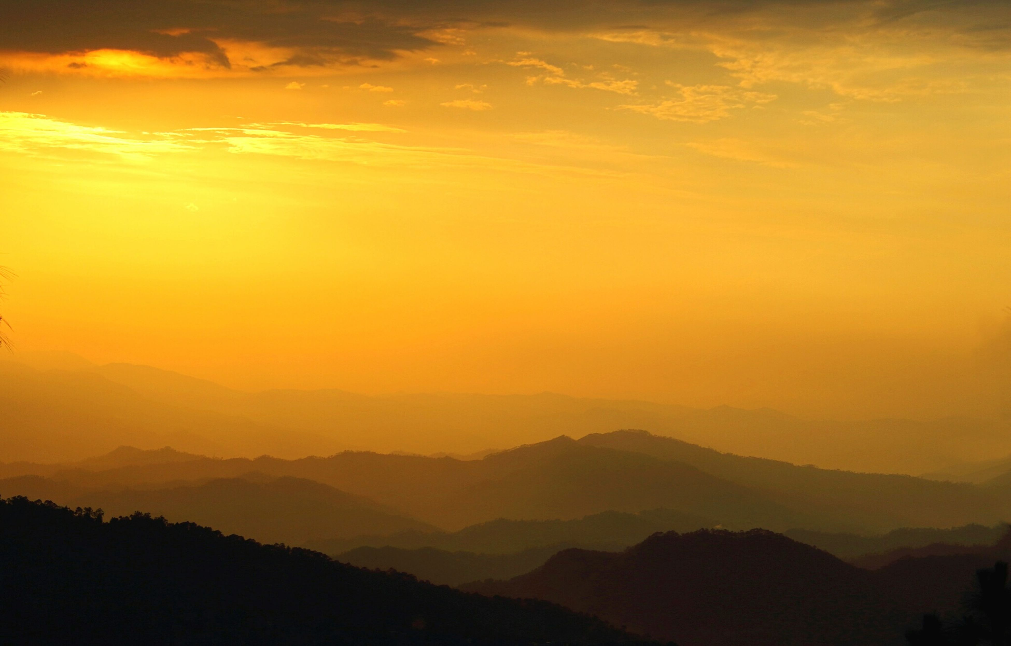 sunset, nature, silhouette, orange color, beauty in nature, tranquil scene, scenics, sky, mountain, tranquility, outdoors, no people, tree, landscape, mountain range, day