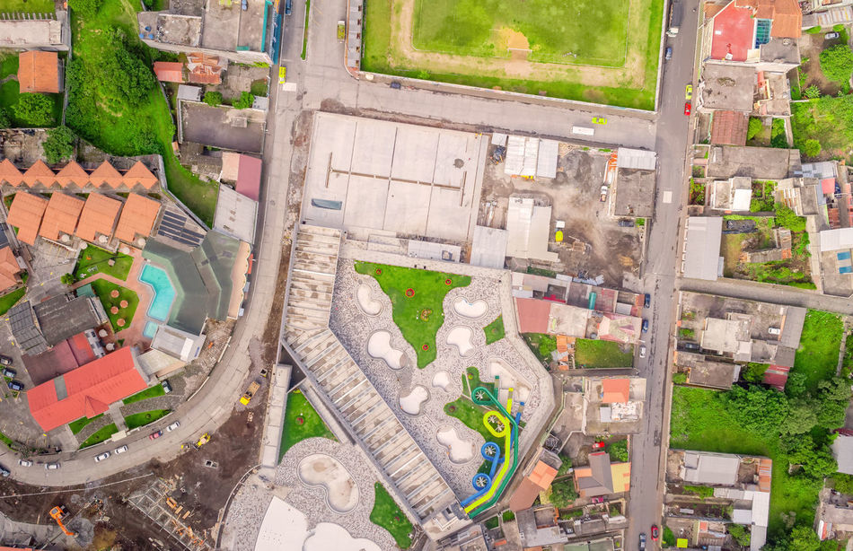 Aerial Photo From Flying Drone Of Banos De Agua Santa, Touristic Town, Tungurahua Province, South America Aerial Aerial Photography Aerial Shot Aerial View Andes Architecture BañosEcuador City City City Street Cityscape Cityscape Cityy Day Drone  Dronephotography Droneshot High Angle View Mountains No People Outdoors Roof South America Summer View From Above