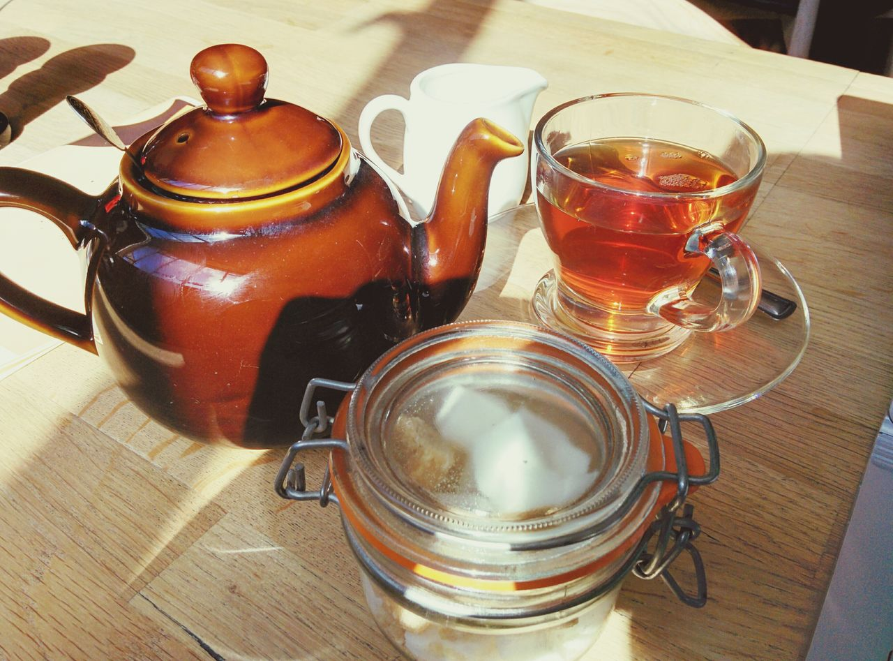 table, drink, food and drink, refreshment, teapot, tea - hot drink, indoors, wood - material, no people, high angle view, freshness, drinking glass, jar, close-up, herbal tea, healthy eating, food, day, mint tea