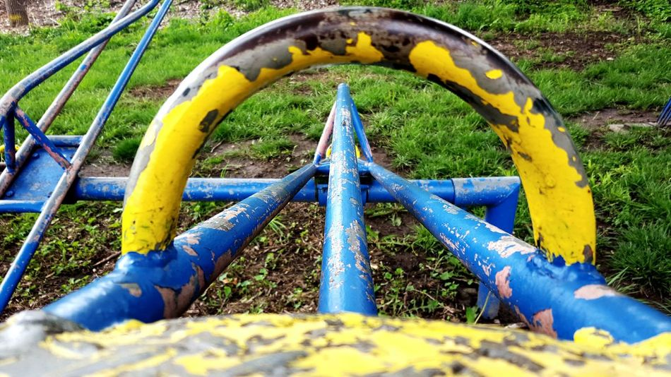 Chipped Chipped Paint Blue And Yellow Yellow And Blue Play Playground Playing Playtime Playground Equipment Vintage The Past Playgrounds Teeter-totter Teeter-Totter Time Metal Curves Vintage Photo Fun Antique Peeling Peeling Paint Playground Fun Playground Structure Break Taking A Break