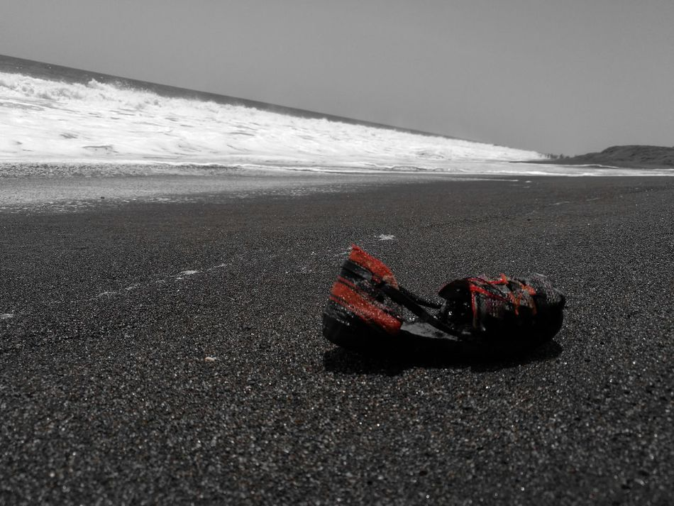 Beach Sea Sand Outdoors No People Black And White Black & White Black And White Photography Black And White Collection  Red Color Red Shoe Monterrico Beach Guatemala Horizon Over Water Close-up Artistic Photo Art Photography Lonelyplanet Lonely Objects Lonely Beach Lonely Place  Baby Shoe Sand & Sea Welcome To Black