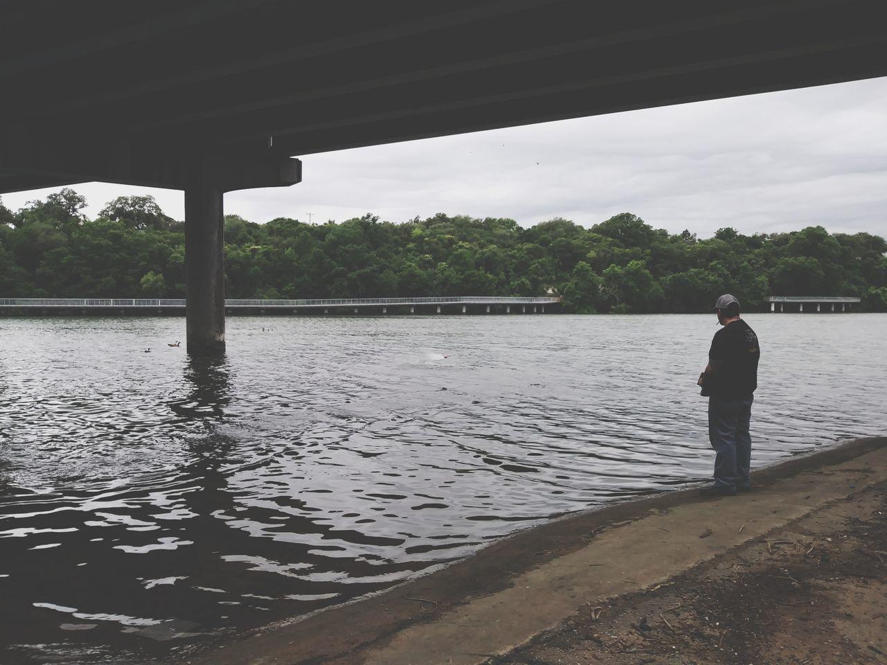 The Street Photographer - 2017 EyeEm Awards One Man Only Full Length Bridge - Man Made Structure Austin Texas Festival Beach Ladybird Lake A Man And His Toys Rc Boat Hobbies Under A Bridge RC Underpass