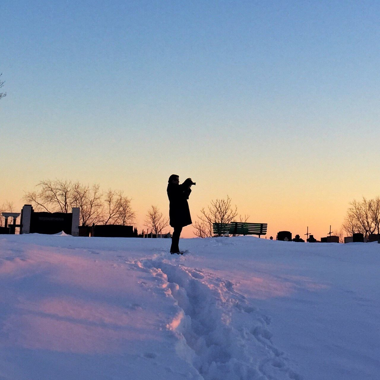 Shoot the sunset One Person Winter Sunset Sunset Silhouettes Week On Eyeem Photographer Photograph Silhouette Montréal