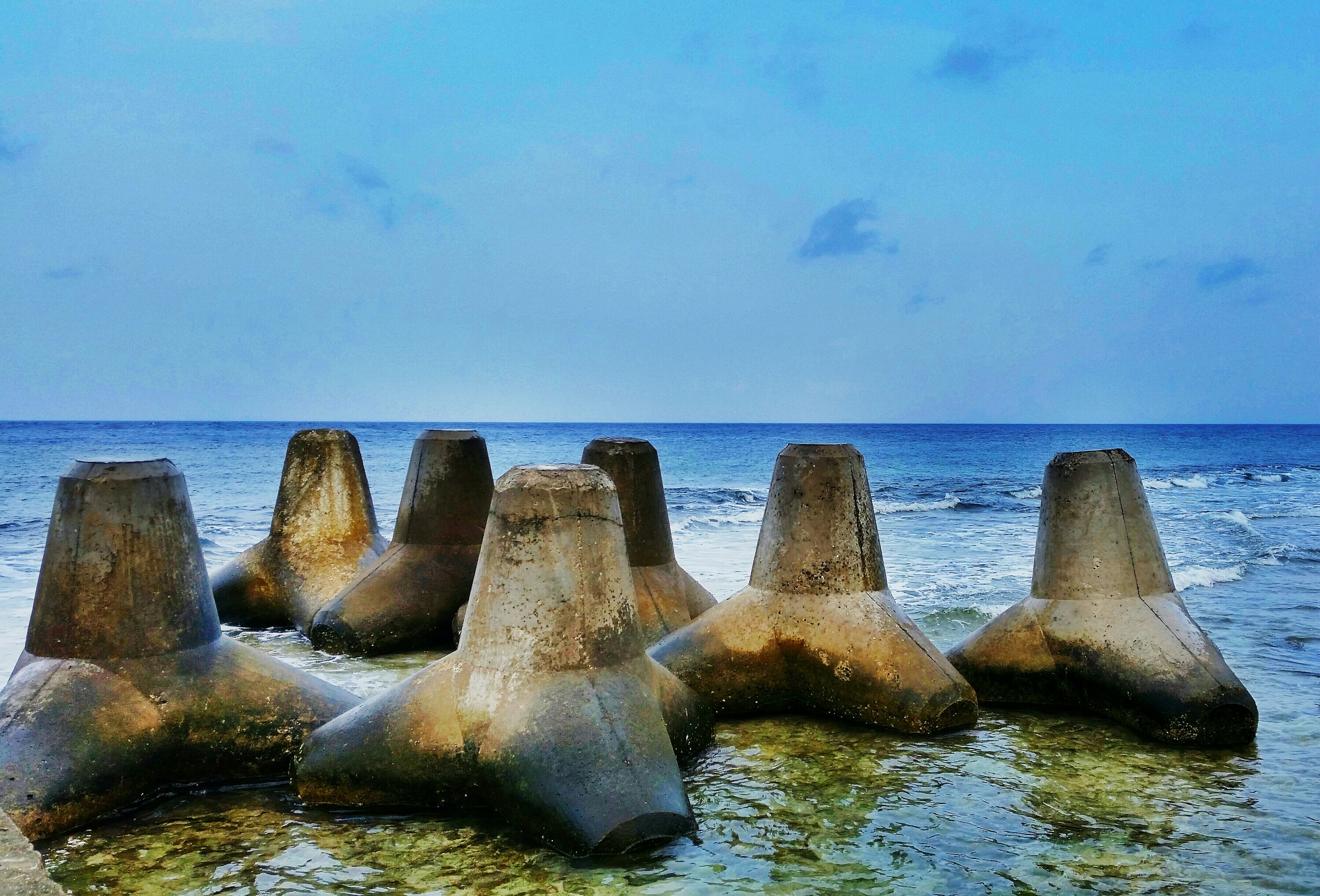sea, horizon over water, water, scenics, tranquil scene, beauty in nature, tranquility, sky, rock - object, nature, beach, blue, idyllic, shore, rock formation, waterfront, outdoors, wave, remote, day