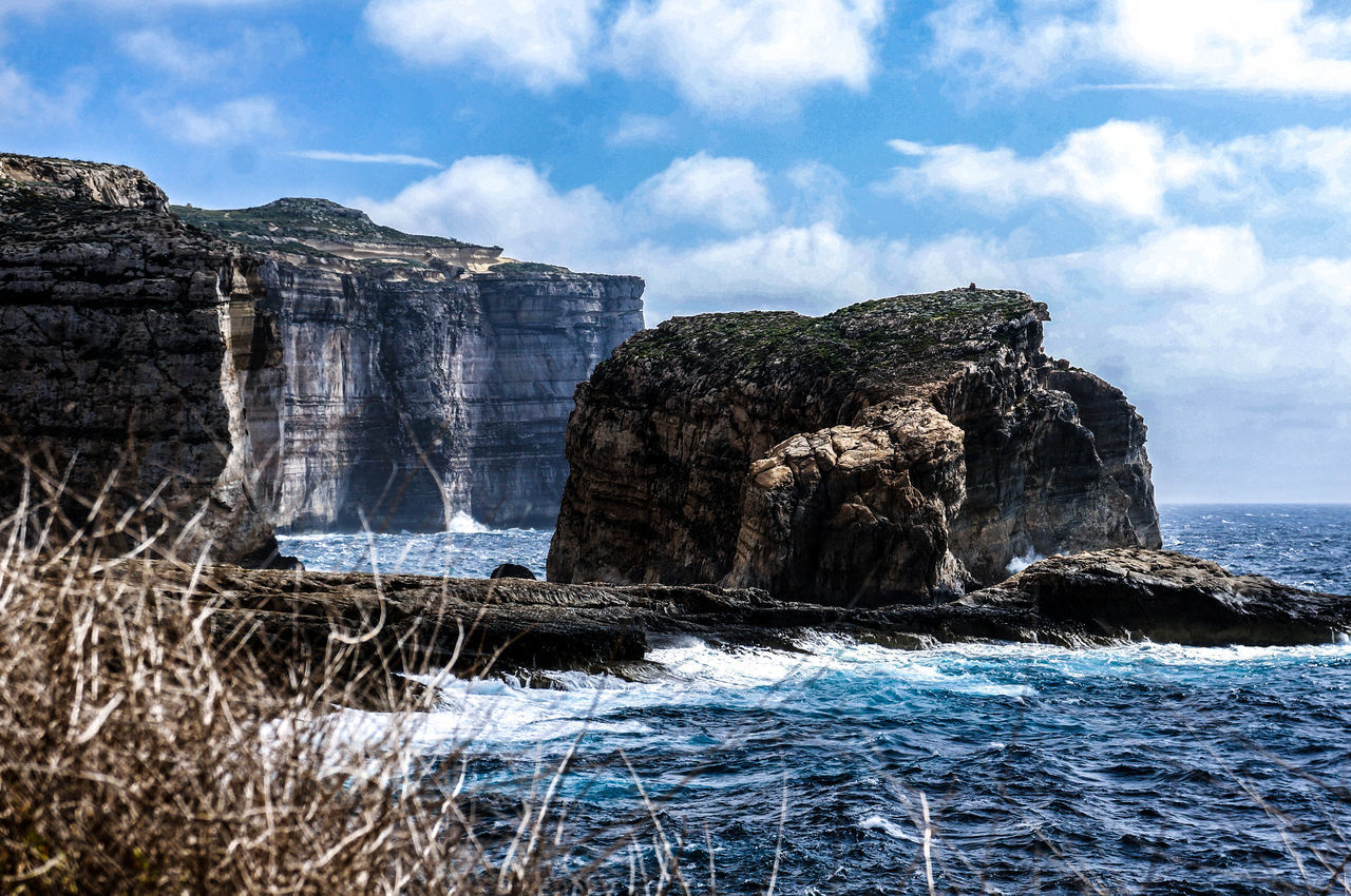 Cliffs, rough sea and rock in Gozo, Malta Beauty In Nature Cliff Cloud - Sky Coast Geology Gozo Huge Landscape Malta Mountain Nature Nature Ocean Outdoors Panorama Rock Rock - Object Rock Formation Rough Scenics Sea Sea And Sky View Water Waves EyeEmNewHere